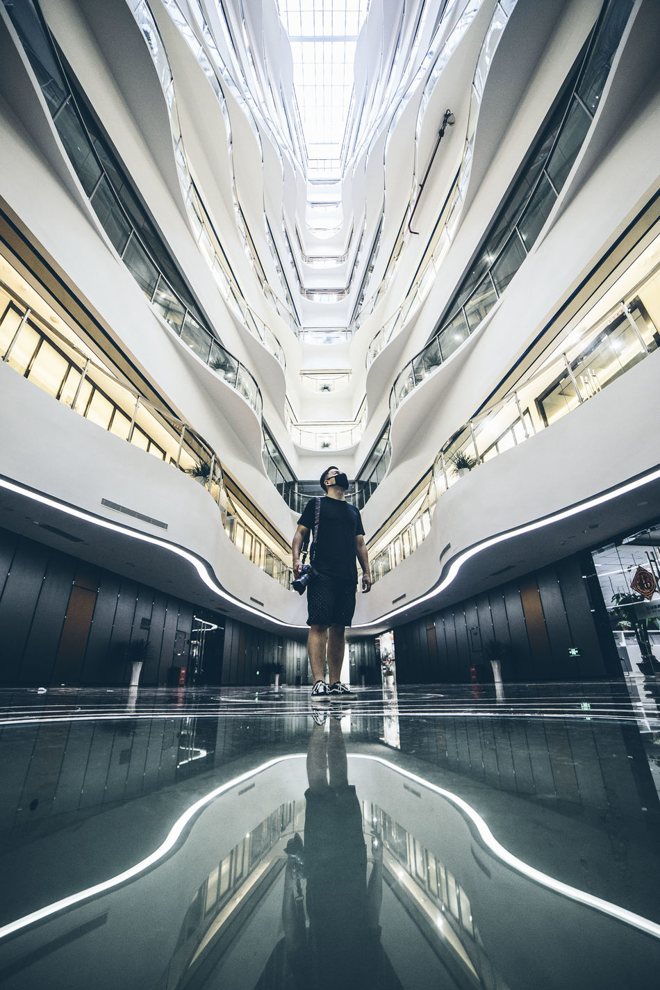 Architecture Building Exterior Built Structure City City Life Day Diminishing Perspective Leisure Activity Lifestyles Lookup Man Modern Road Shenzhen The Way Forward Unrecognizable Person Vanishing Point