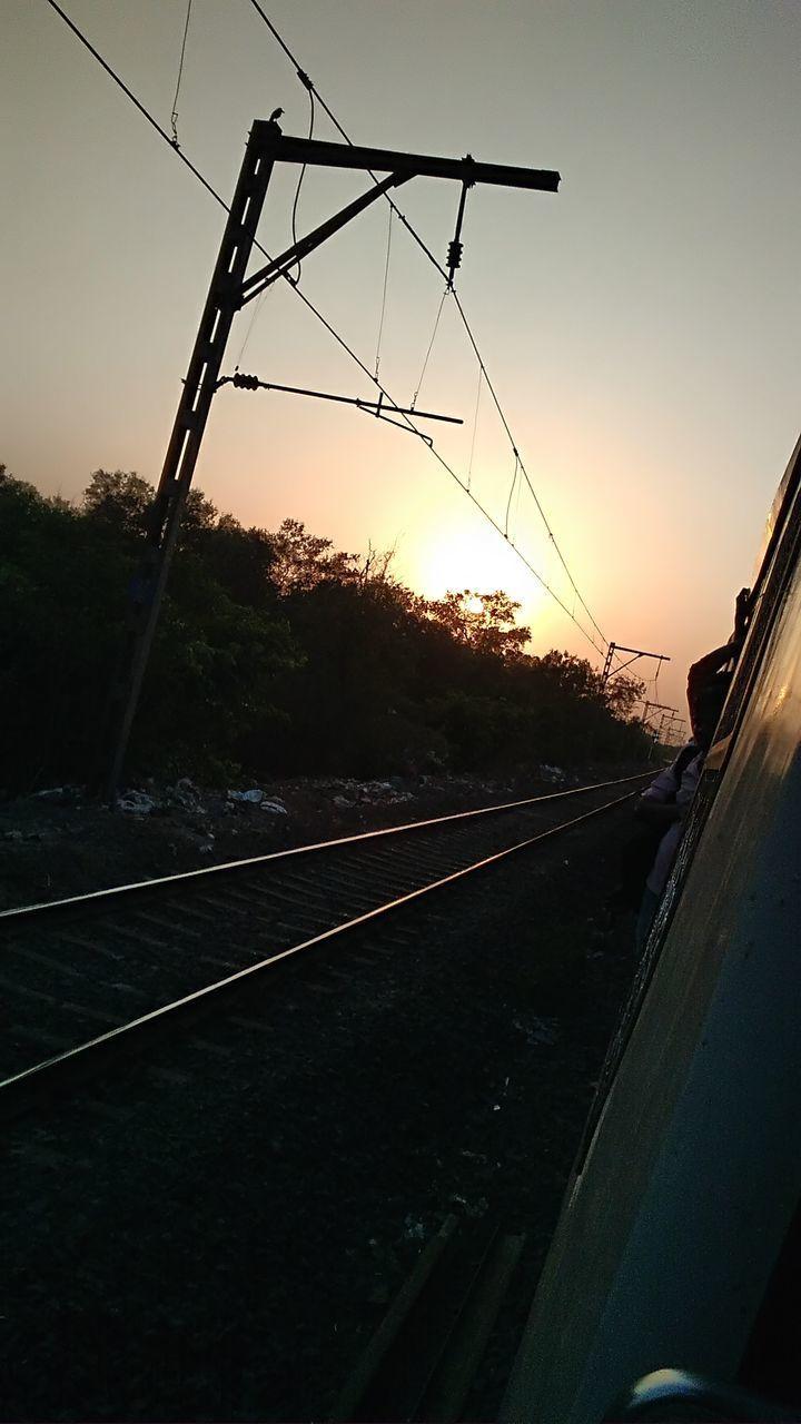 sunset, transportation, rail transportation, railroad track, no people, mode of transport, sky, train - vehicle, public transportation, outdoors, tree, clear sky, nature, day
