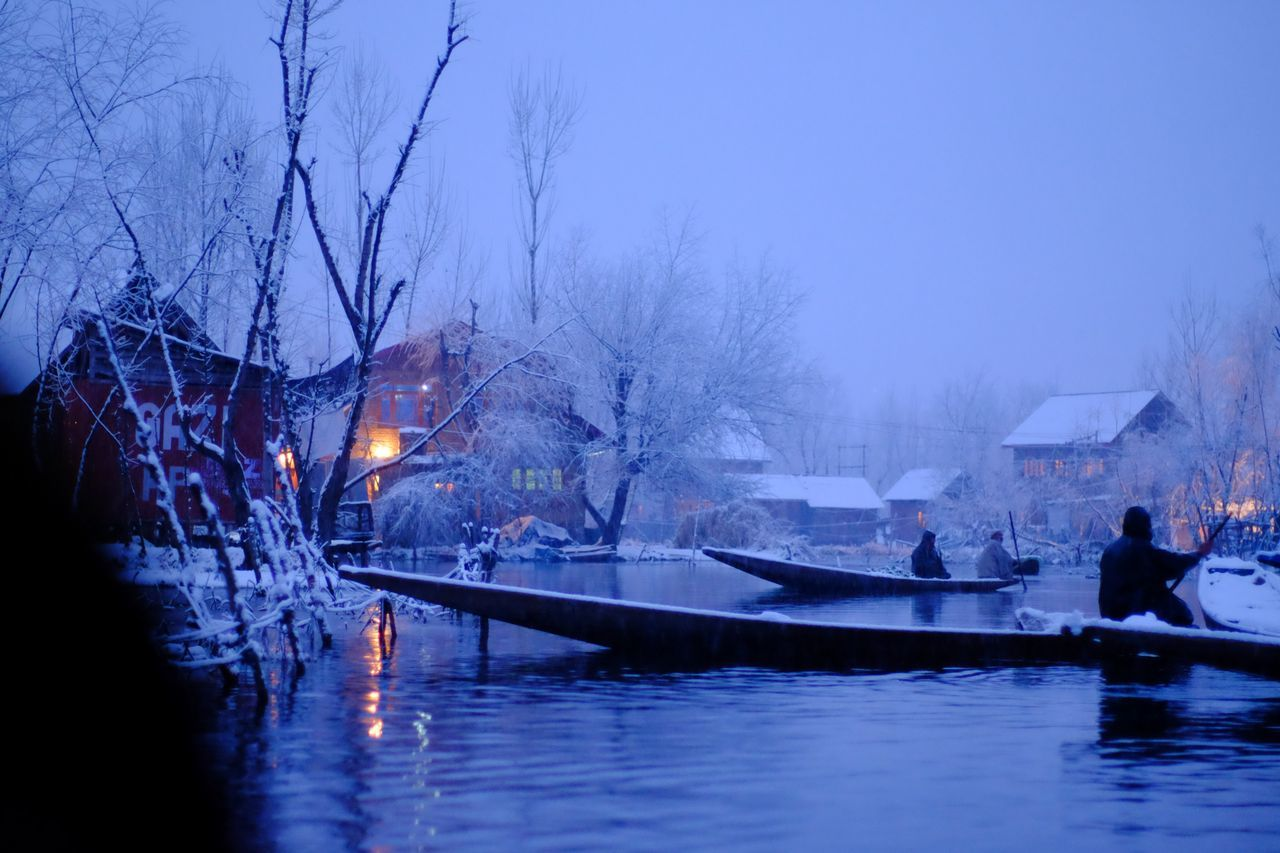 seller at floating market in Srinagar Architecture Bare Tree Beauty In Nature Built Structure Cold Temperature Dal Lake Day Floating Market Kashmir Nature Nautical Vessel Outdoors Real People Reflection Sky Snow Srinagar Kashmir Travel Destinations Tree Water Waterfront Winter