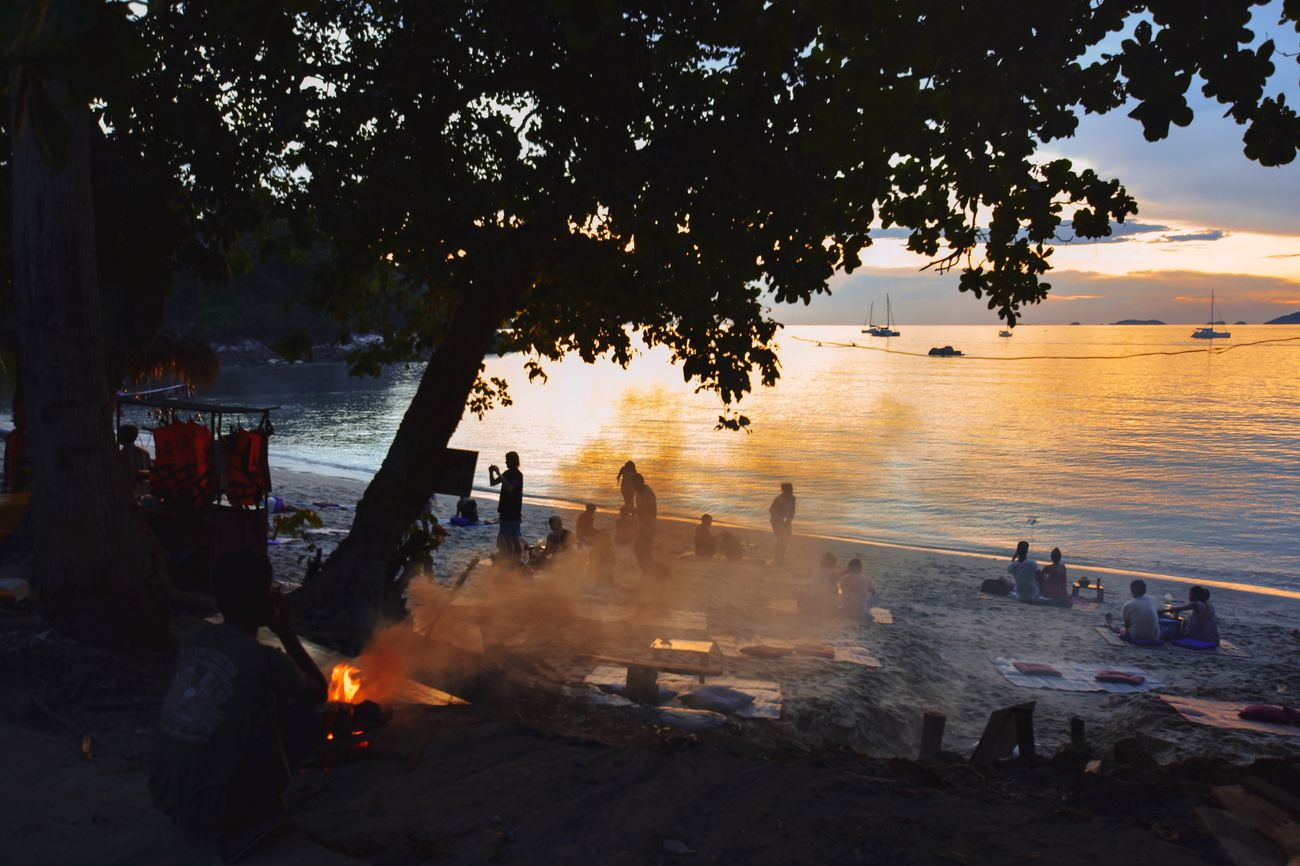 Water Sea Nature Outdoors Beach Sunset People Scenics Beauty In Nature Fire Fire And Smoke Smoke Beach Sunset Beach Life Barbecue Travel Photography Thailand_allshots Koh Lipe Hanging Around Chilling Thailand Photos Travelingtheworld  Beachlife Fireplace Evening Light