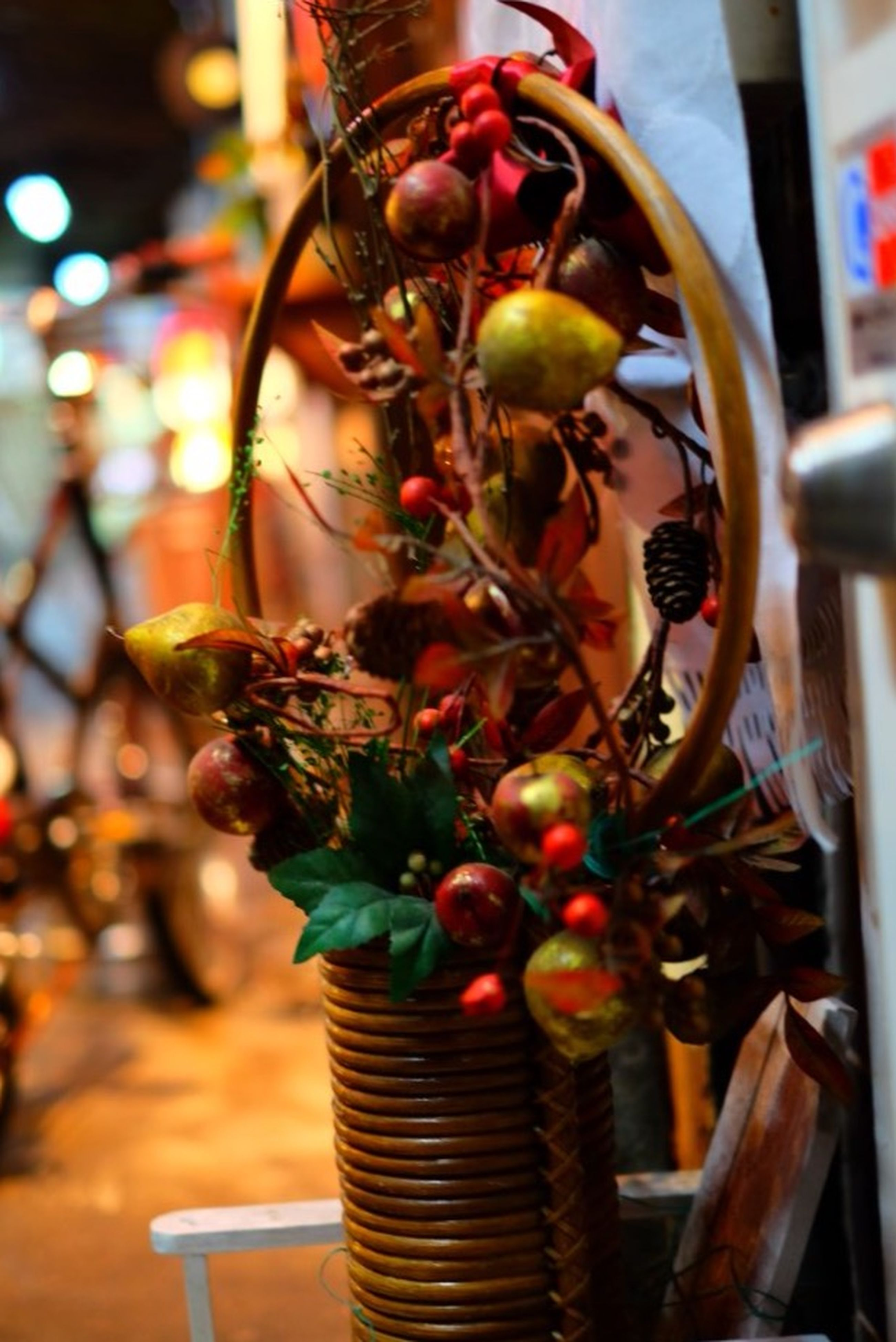 food and drink, indoors, hanging, focus on foreground, still life, food, freshness, close-up, fruit, decoration, table, healthy eating, selective focus, large group of objects, abundance, variation, tradition, no people, retail, for sale