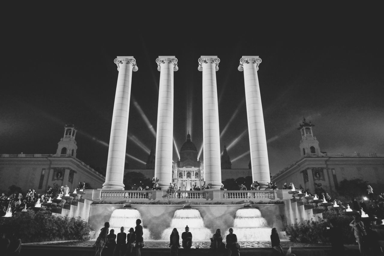 large group of people, real people, built structure, women, lifestyles, men, architecture, travel destinations, leisure activity, tourism, building exterior, night, travel, mixed age range, architectural column, outdoors, illuminated, crowd, sky, adult, people, adults only