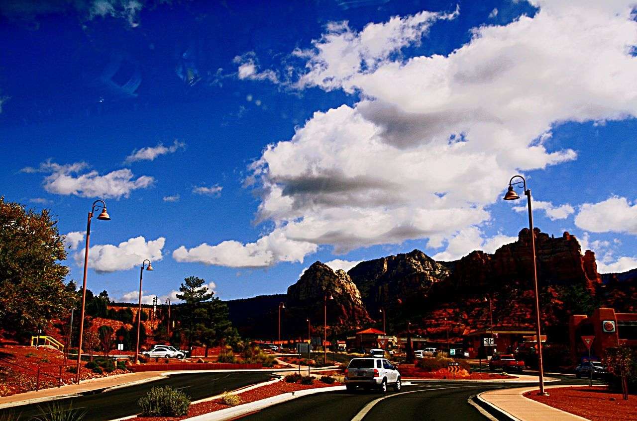cloud - sky, sky, car, land vehicle, road, transportation, outdoors, day, street light, no people, architecture, tree, nature, city