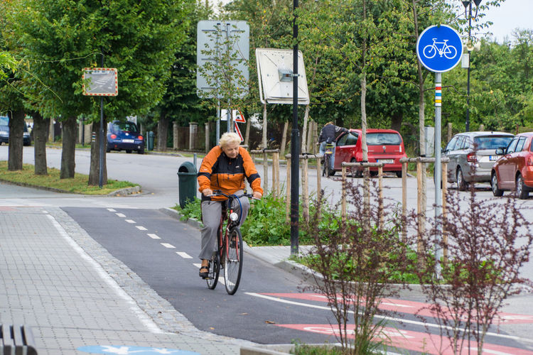 Trebon Chez Republic promotes bicycle riding for young and seniors. Adult Adults Only Bicycle Bike Lane City Cycling Day Full Length Land Vehicle Man Men Mode Of Transport One Man Only One Person Only Men Outdoors Pedal People Road Sign Senior Adult Sports Event  Transportation Transportation Tree