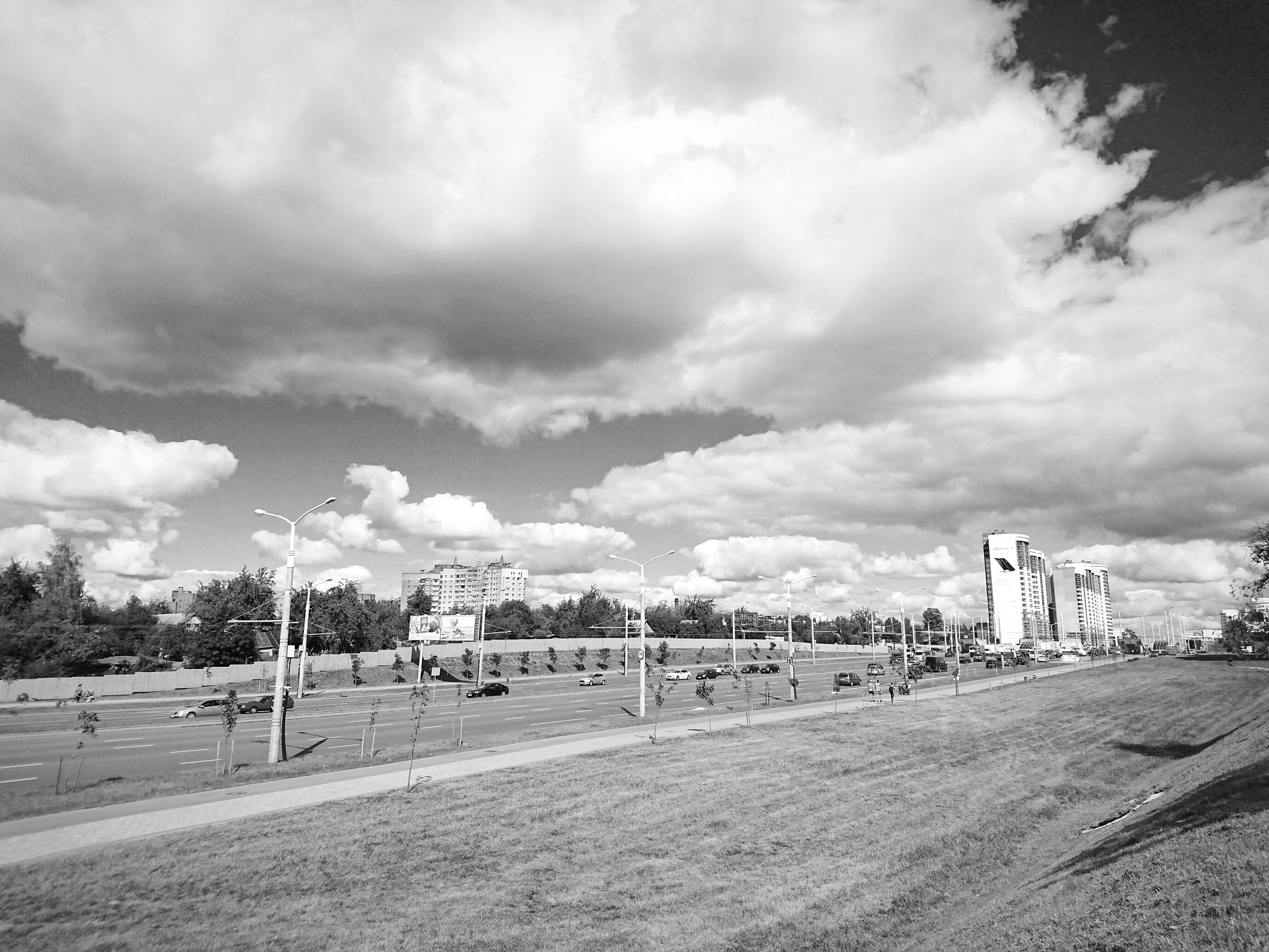transportation, land vehicle, sky, mode of transport, car, cloud - sky, road, cloudy, cloud, day, outdoors, city life, the way forward, no people