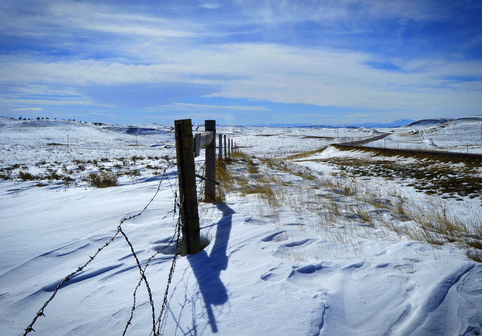 Fence line near highway 270 Wyoming Cold Temperature Day Landscape Nature No People Outdoors Sky Snow Winter