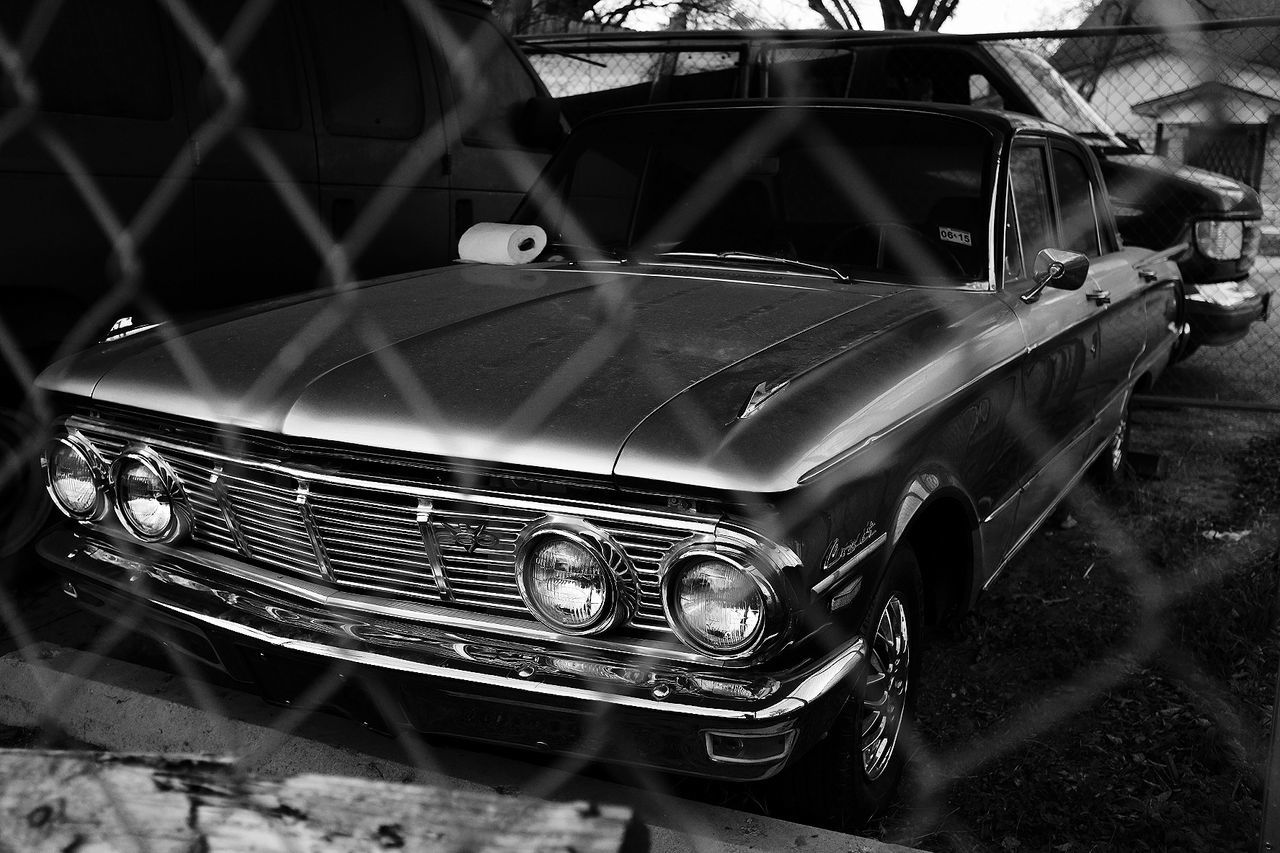 I keep it clean though... Outdoors Day No People Beauty Black And White Metal Black & White Architecture Built Structure Classic Cars Classic Car Pattern Safety Fence Chainlink Fence Art Headlight