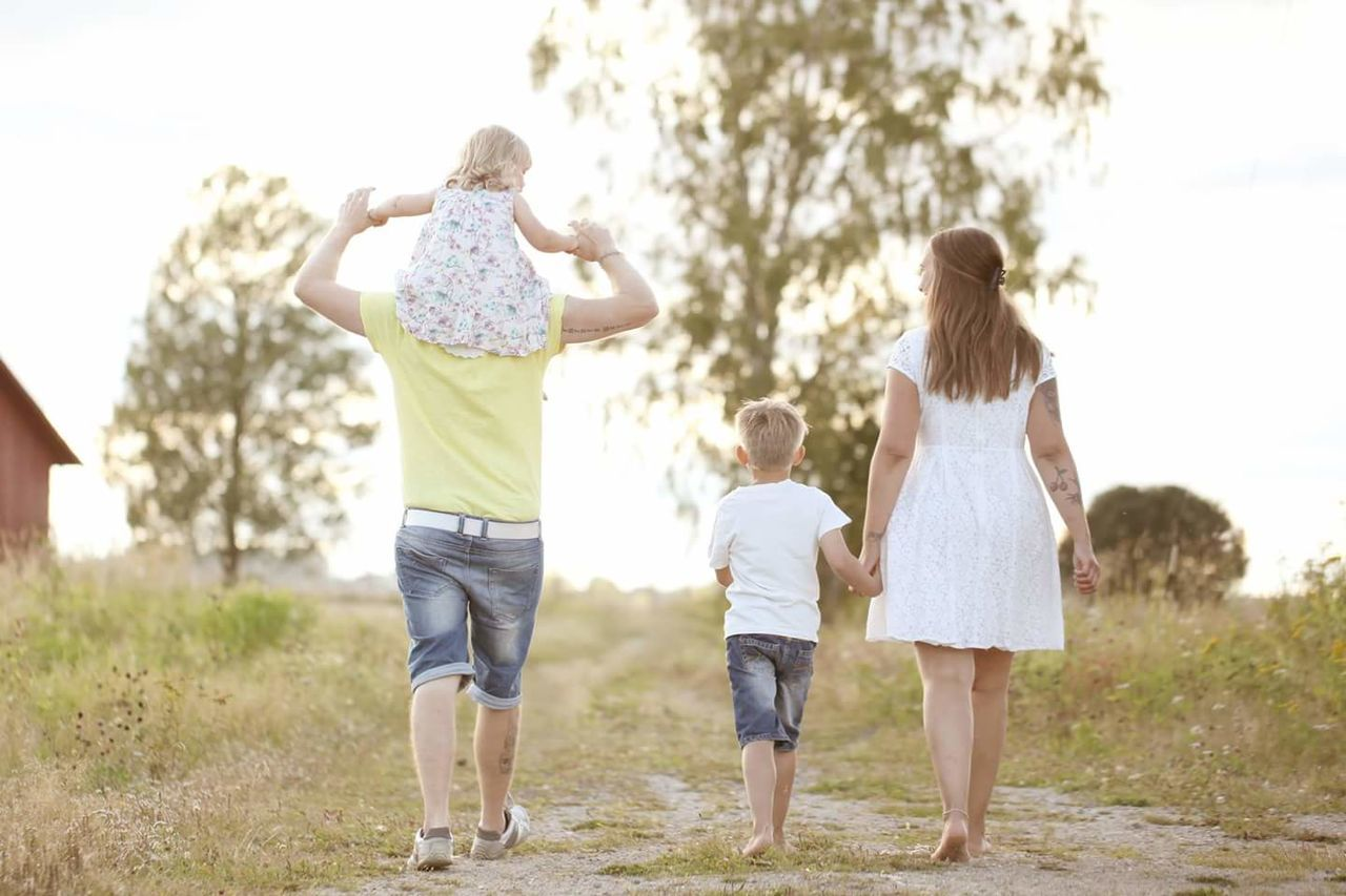 Family. Rear View Family Small Group Of People Child Walking Happiness Offspring Enjoyment Bonding Human Back Nature