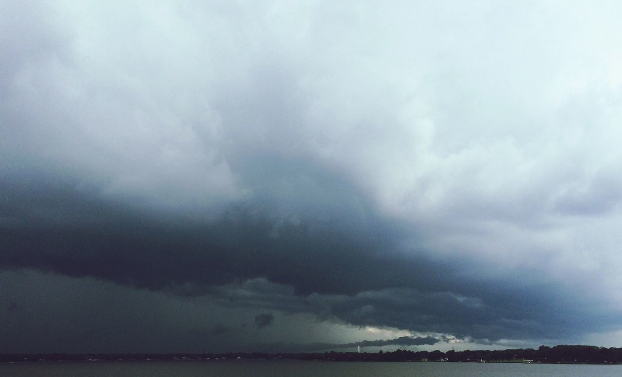 cloud - sky, storm cloud, sky, weather, nature, storm, sea, scenics, beauty in nature, thunderstorm, atmospheric mood, dramatic sky, tranquility, water, no people, horizon over water, outdoors, tranquil scene, power in nature, awe, day, lightning, forked lightning