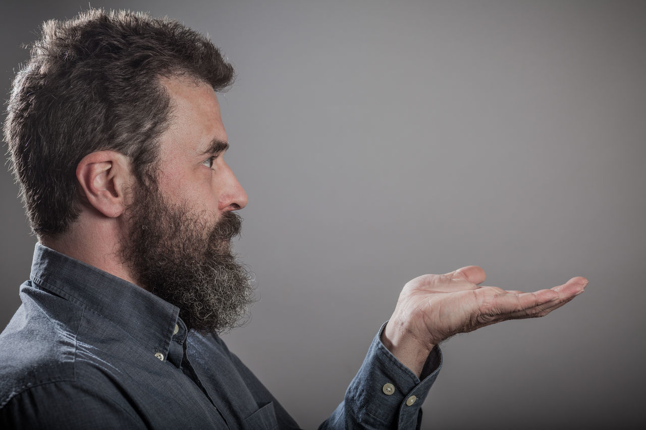 Mature man with long beard, head shots on grey background Adult Adults Only Beard Close-up Day Emotions Gray Background Grey Background Hand Headshot Holding Human Body Part Human Hand Indoors  Men One Man Only One Person Only Men People Real People Series Studio Shot Young Adult