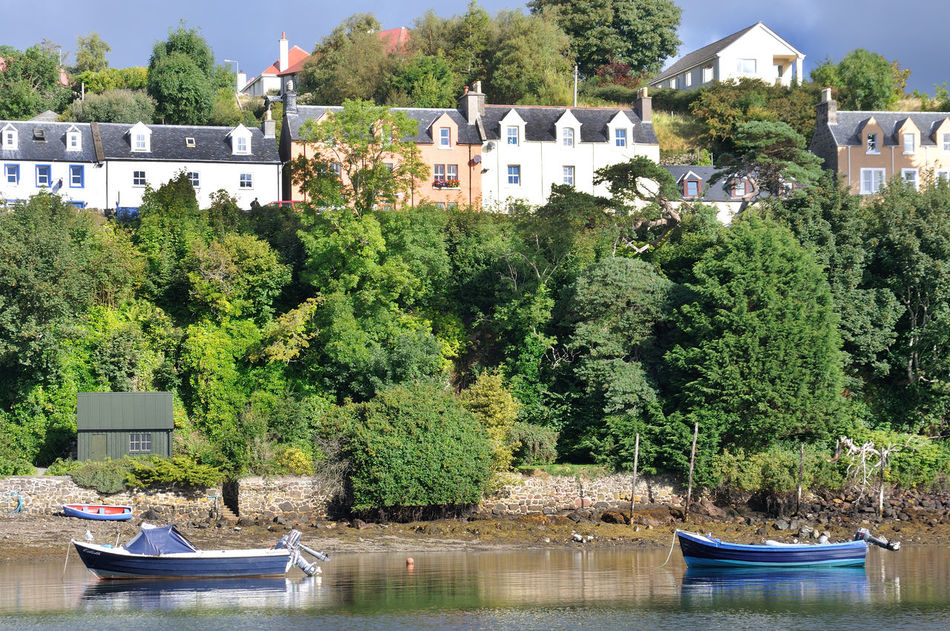 The harbour at Portree, isle of Skye Architecture Boat Coast Harbour Highlands No People Portree Scotland Skye Tourism Town Tranquility Travel Destinations Tree Water