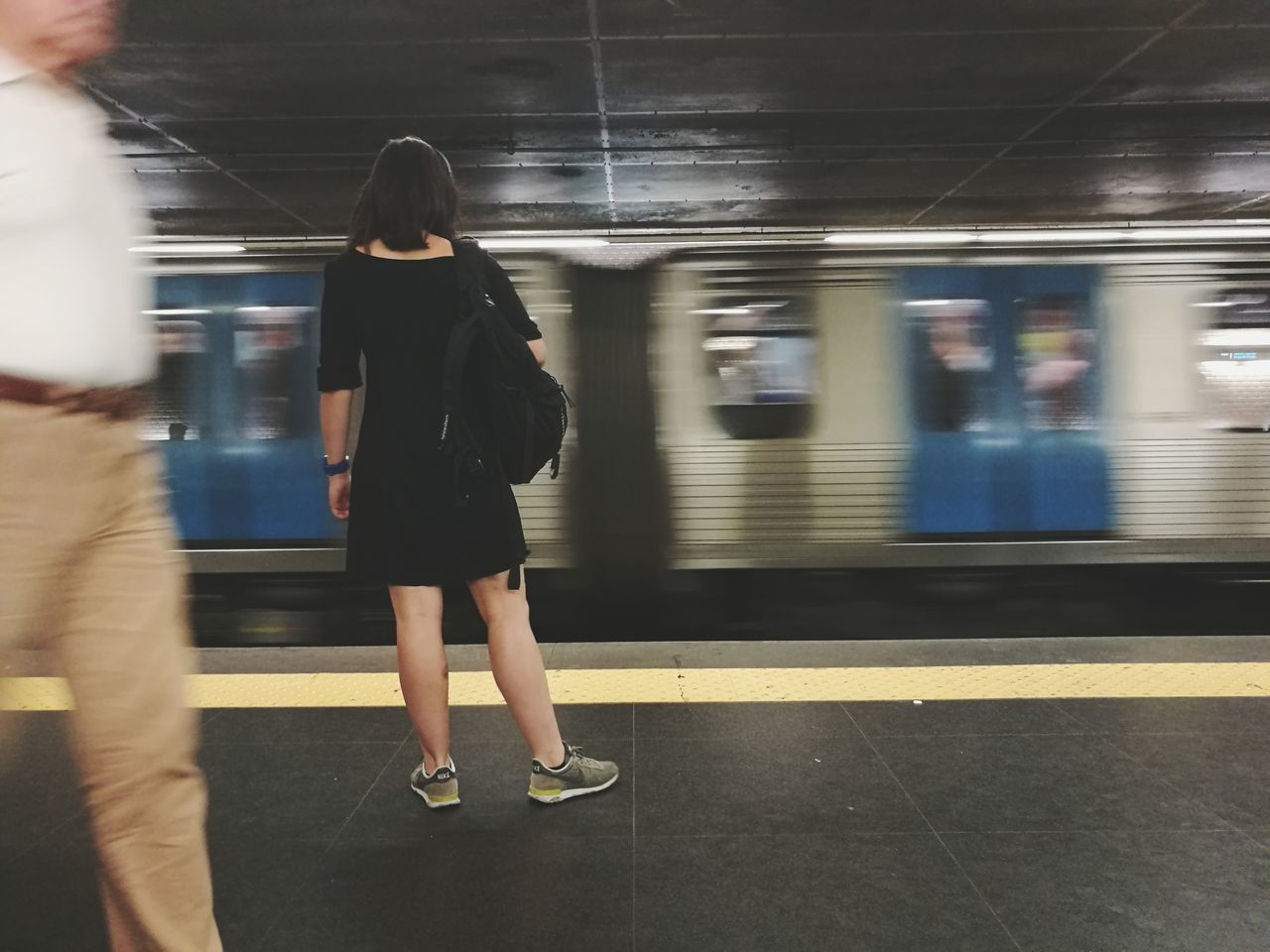 blurred motion, motion, transportation, speed, real people, train - vehicle, mode of transport, casual clothing, long exposure, public transportation, railroad station platform, railroad station, full length, two people, lifestyles, women, indoors, day, people