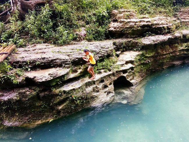 Sunlight Nature Outdoors Day Water One Person Freshness Adventure Waterfalls And Mountains Waterfalls In Philippines Power In Nature Waterfalls Of Time Green Color Waterfall Beauty In Nature Nature Scenics Only Women Vacations