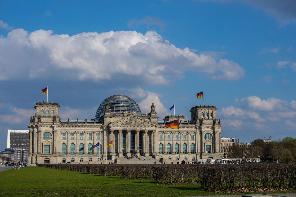 Reichstag Building in Berlin, Germany. Blue sky with upcoming clouds. Flags of germany and europe. Architecture Berlin Building Exterior Built Structure City Cloud - Sky Day Dome European Flag Flag German Flag Germany History Outdoors People Reichstag Reichstagsgebäude Reichstagskuppel Sky Travel Travel Destinations Waiting