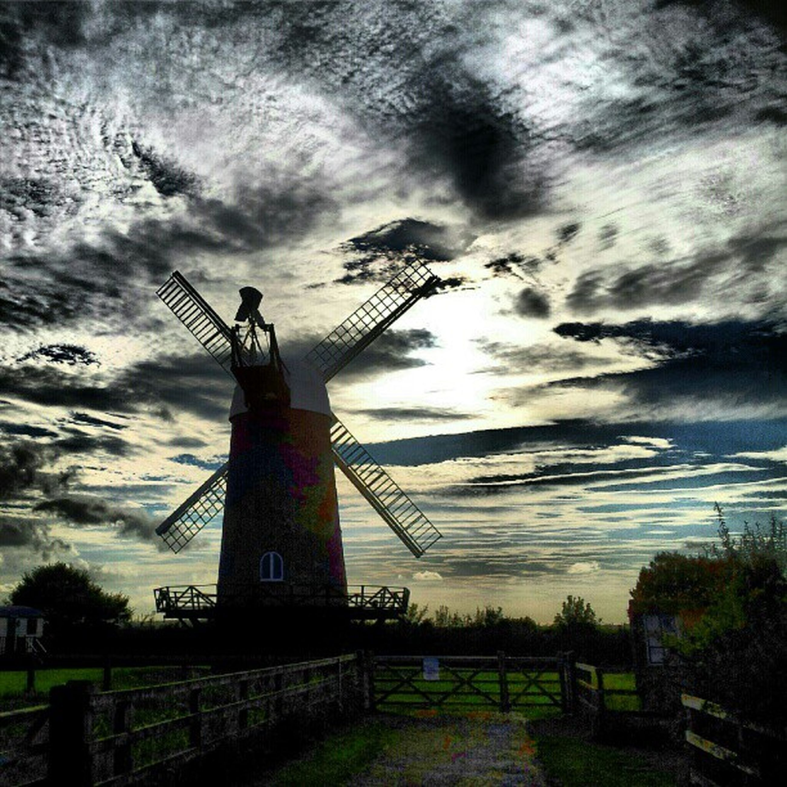 sky, cloud - sky, cloudy, sunset, field, cloud, fuel and power generation, silhouette, built structure, low angle view, lighthouse, nature, dusk, weather, landscape, dramatic sky, technology, tranquility, guidance, architecture