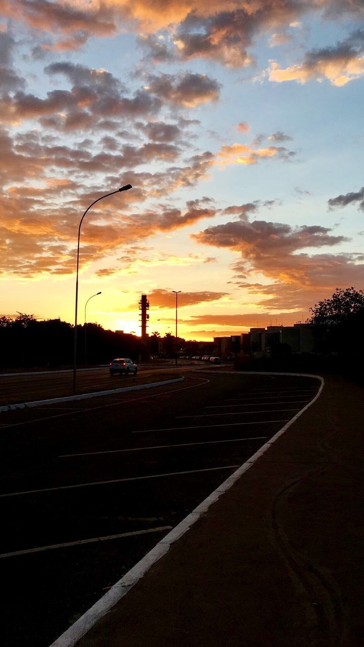 sunset, road, sky, transportation, cloud - sky, the way forward, no people, silhouette, street light, outdoors, curve, tree, running track, nature, day