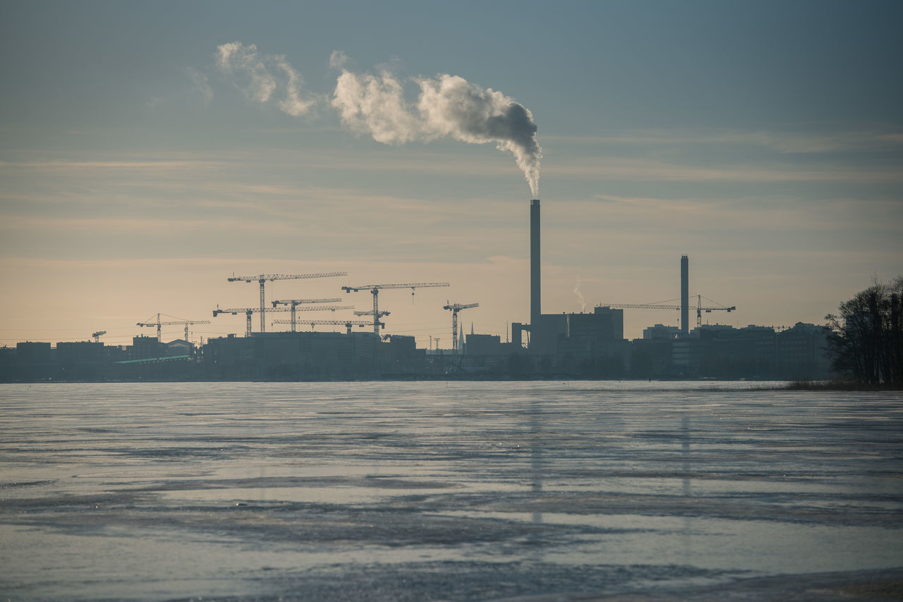 Air Pollution Business Finance And Industry Cold Temperature Day Ecosystem  Environment Factory Finland Fuel And Power Generation Fumes Gas Helsinki Industry Lammassaari No People Outdoors Petrochemical Plant Refinery Sea Sky Smoke Stack Social Issues Sunlight Sunset Winter