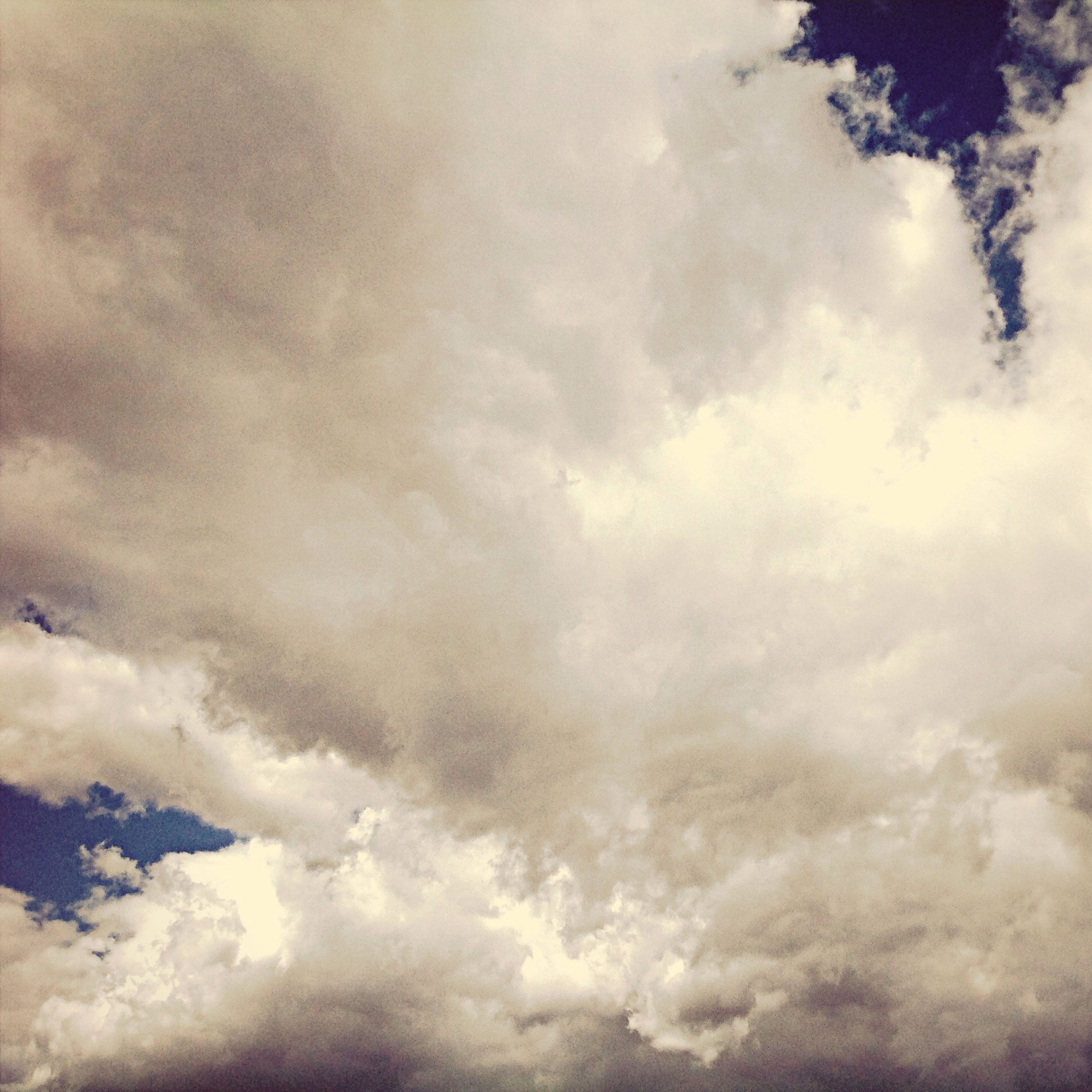 cloud - sky, sky, cloudy, beauty in nature, scenics, weather, tranquility, cloudscape, tranquil scene, low angle view, nature, sky only, overcast, cloud, idyllic, backgrounds, full frame, outdoors, storm cloud, no people