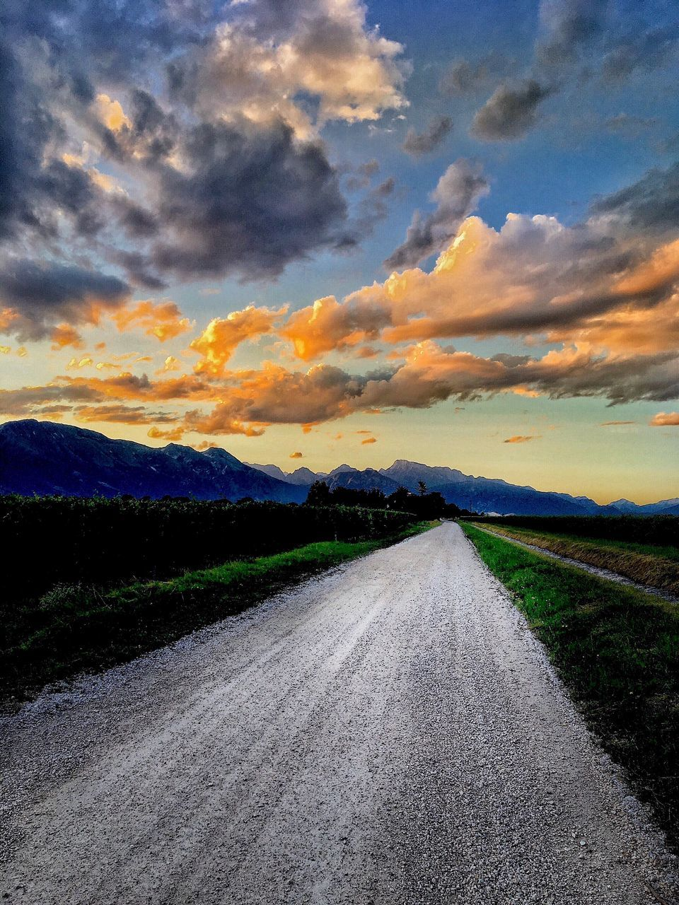 road, the way forward, scenics, sky, landscape, sunset, tranquil scene, nature, cloud - sky, tranquility, no people, outdoors, transportation, beauty in nature, rural scene, mountain, day