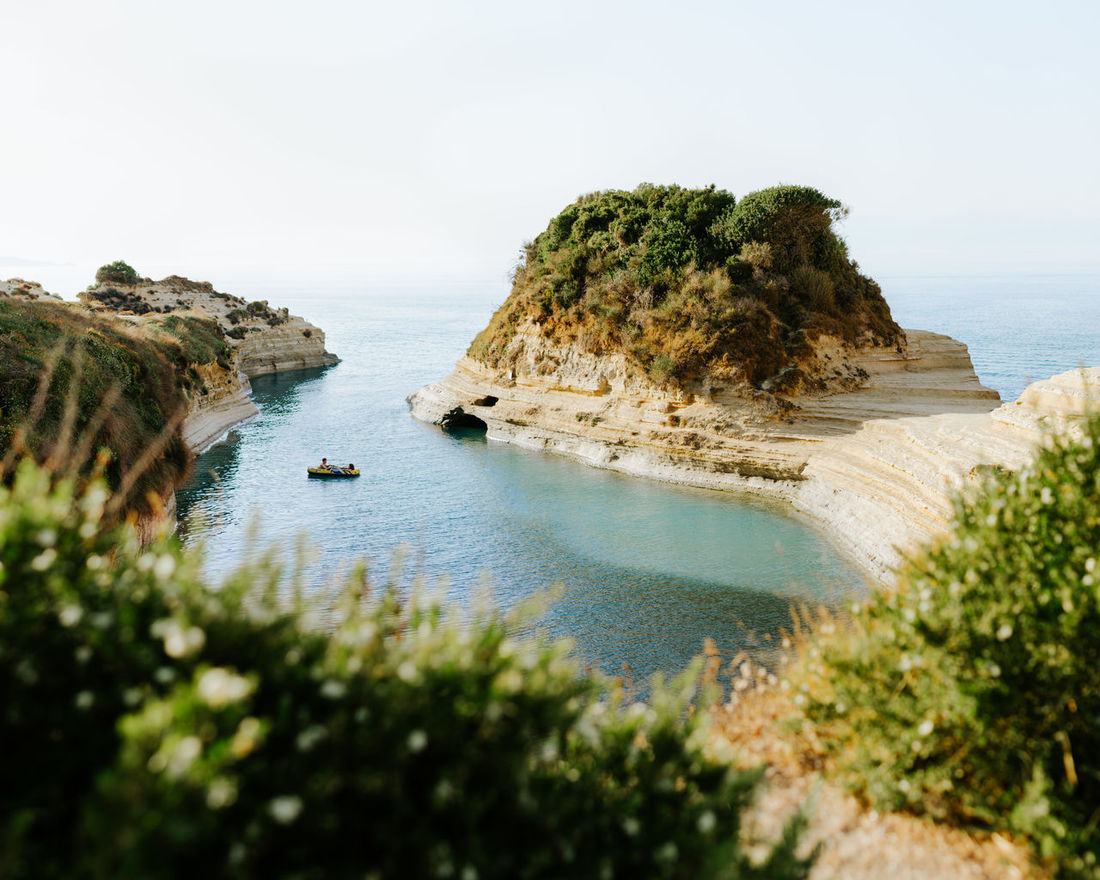 """Peace and tranquility to earth"" Beach Alone Alone Time Beach Boat Canal D'Amour Cliff Corfu Day Dinghy Golden Hour Greece Greek Islands Green Color Horizon Over Water Hot Day Kerkyra Lonely Lookslikefilm Mediterranean  Peace And Quiet Peaceful Peaceful Place Relaxing Sea EyeEm Selects"