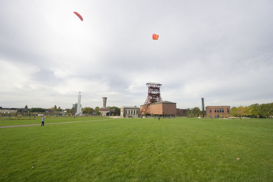 men with power kites - action in an old industrial area with a shaft tower Adrenaline Junkie Architecture Building Exterior Flying Flying High Fun Gelsenkirchen Germany Grass Industrial Building  Kite Kite Flying Kites Leisure Activity Lifestyles Mature Men Men Mid-air NRW Playing Power Kite Ruhrgebiet Shaft Tower Sport Weekend Activities