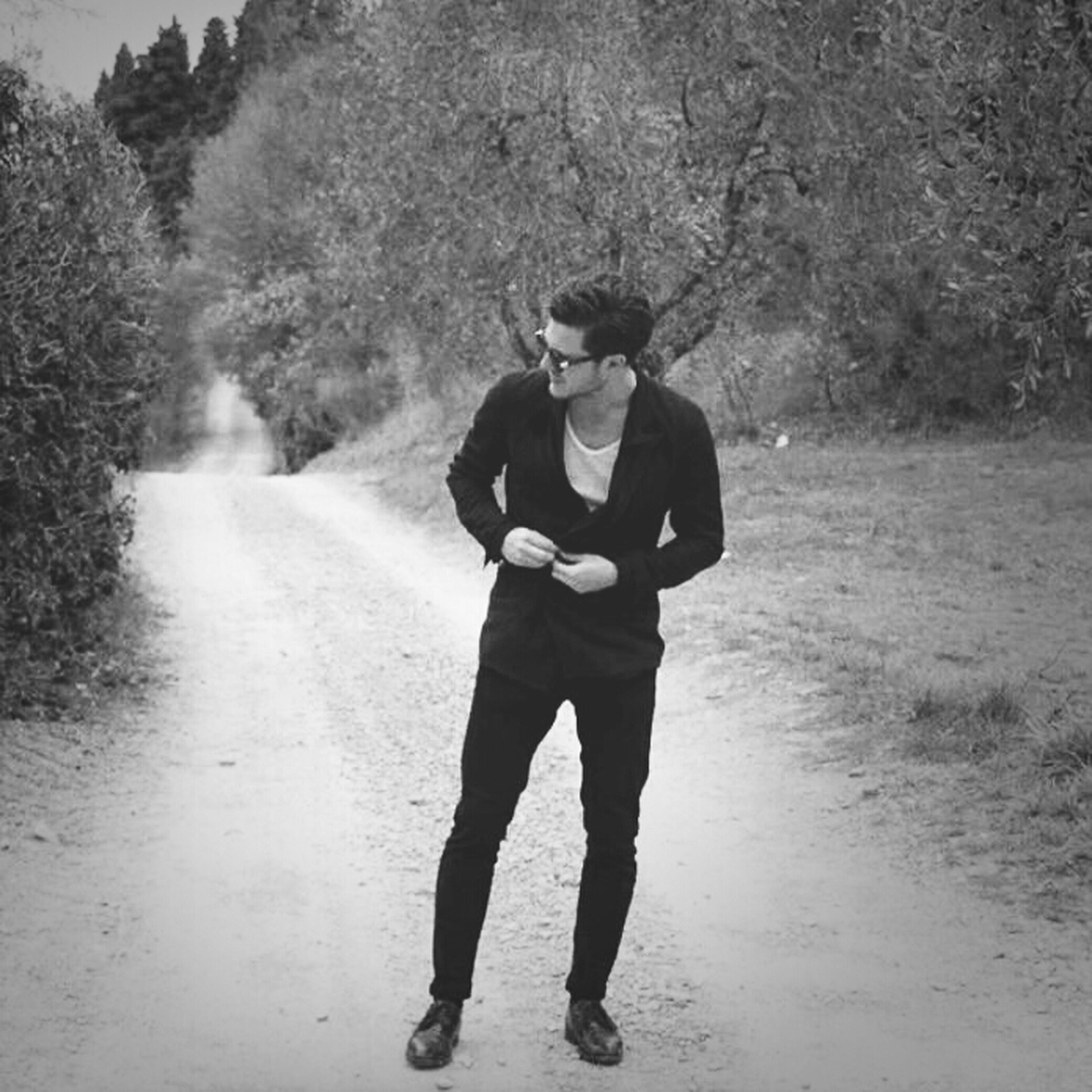 full length, lifestyles, tree, rear view, leisure activity, casual clothing, standing, warm clothing, walking, day, road, men, childhood, person, field, outdoors, nature, front view