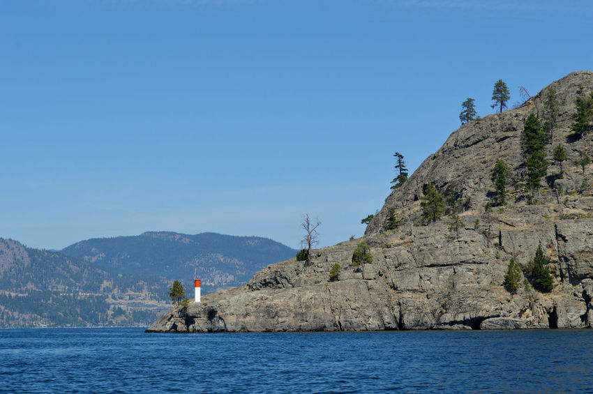 British Columbia Calm Canada Clear Sky Cliff Coastline Day Geology Kelowna,BC Lake Light House Mountain Mountain Range Mountains Nature Okanagan Valley Physical Geography Rock Formation Trees Water Waterfront Waterscape