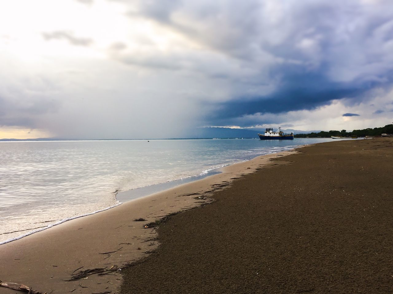 Parottee Bay / Black River | Jamaica Sea Beach Sky Sand Water Cloud - Sky Horizon Over Water Beauty In Nature Scenics Nature Shore Tranquil Scene Tranquility Day Vacations Outdoors No People Travel Destinations Wave Neighborhood Map The Great Outdoors - 2017 EyeEm Awards Tropical Climate Tropical Paradise Sunset