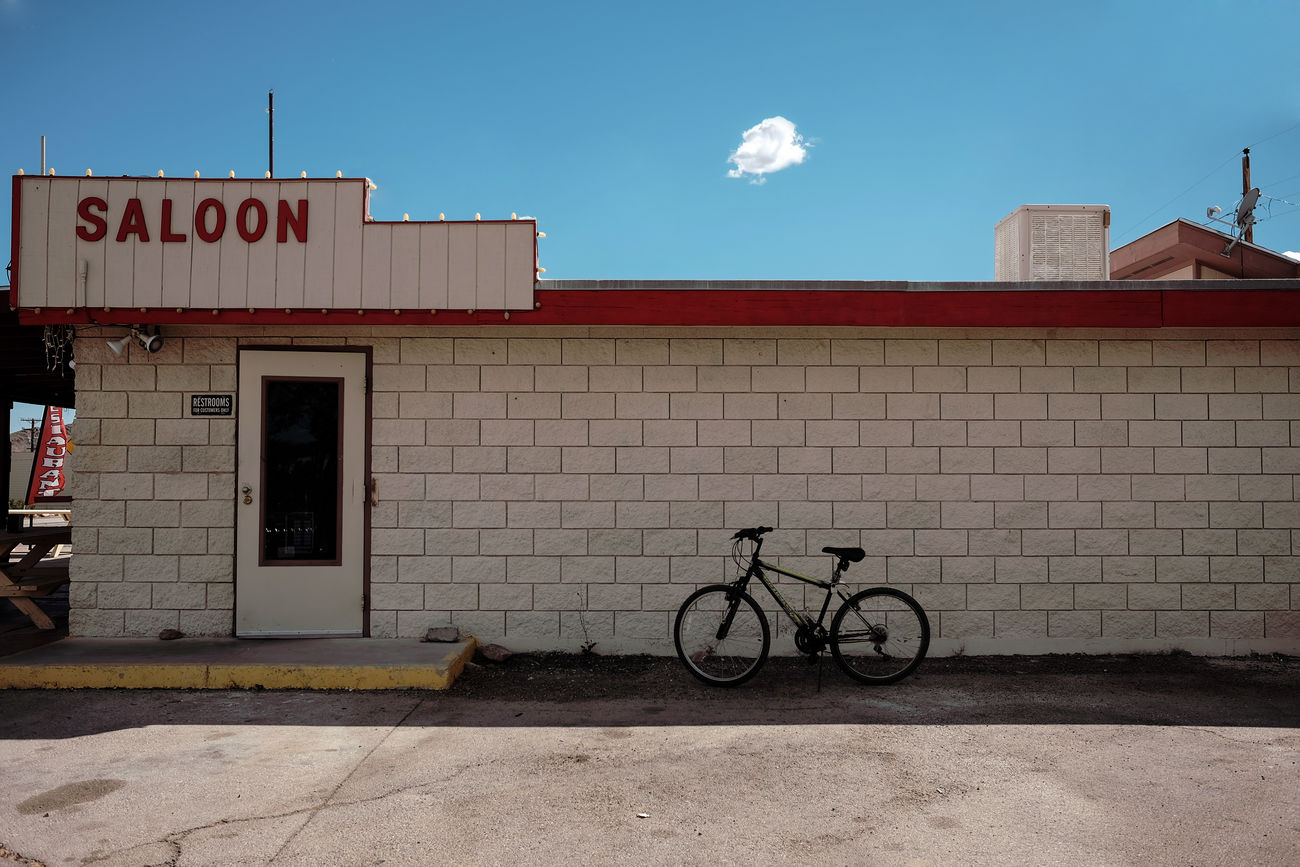 Saloon - Architecture Bicycle Building Exterior Built Structure Day No People Outdoors Sky Text Transportation