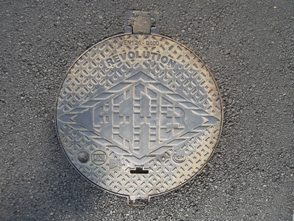 Revolution Asphalt Carving - Craft Product Cast Iron Close-up Day High Angle View Manhole Cover No People Outdoors Streetphotography