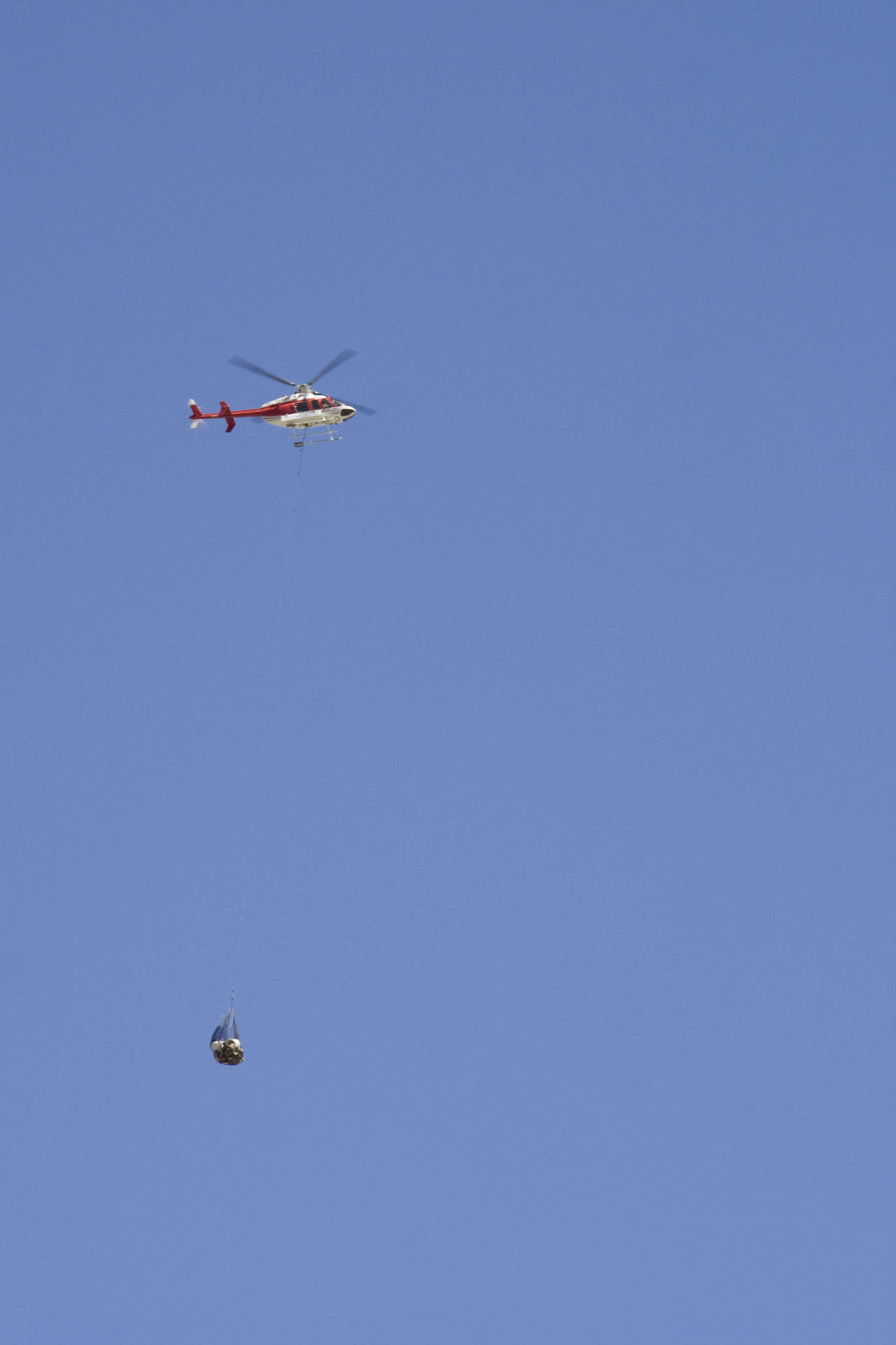 helicopter carrying cargo - canadian rockies, banff national park Aerospace Industry Air Vehicle Aircraft Ambulance Blue Sky Cargo Carrying Clear Sky Emergency Flight Flying Freight Transportation Helicopter Helicopter 🚁 Help Low Angle View Mid-air No People Propeller Rescue Ride Safety Sos Transportation Transportation