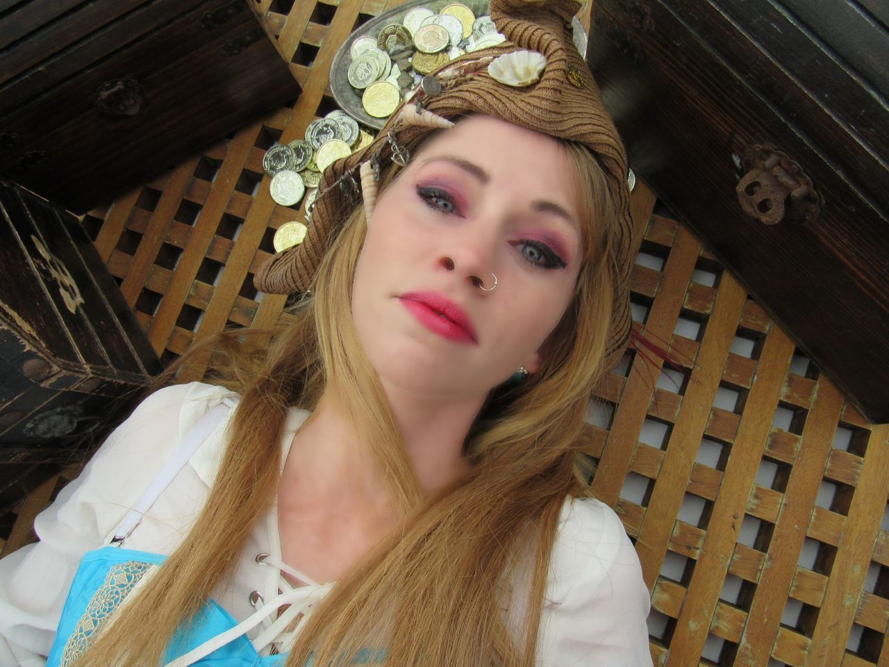 Overhead View Of Woman With Make-Up Lying On Table