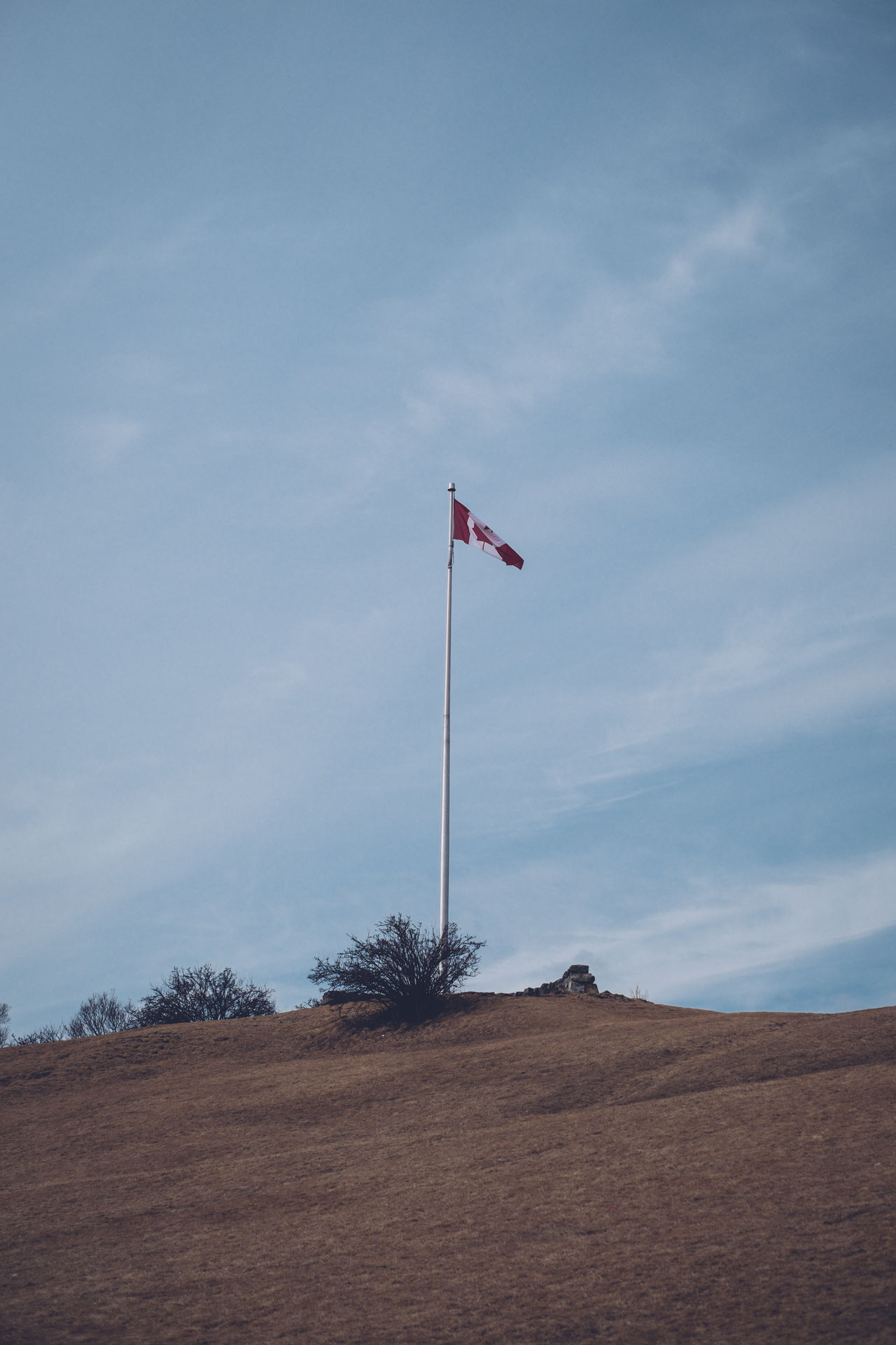 Canada Canadian Flag Cloud - Sky Day Flag Hilltop Low Angle View No People Outdoors Patriotism Sky