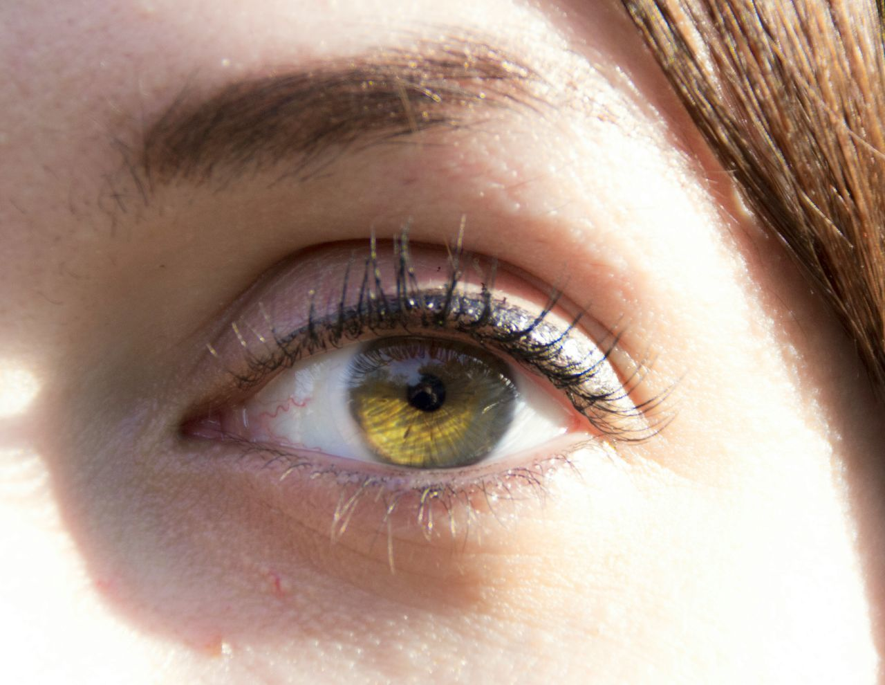 human eye, eyelash, looking at camera, eyesight, human body part, eyeball, close-up, one person, portrait, iris - eye, real people, eyebrow, sensory perception, outdoors, day, hazel eyes, adult, people