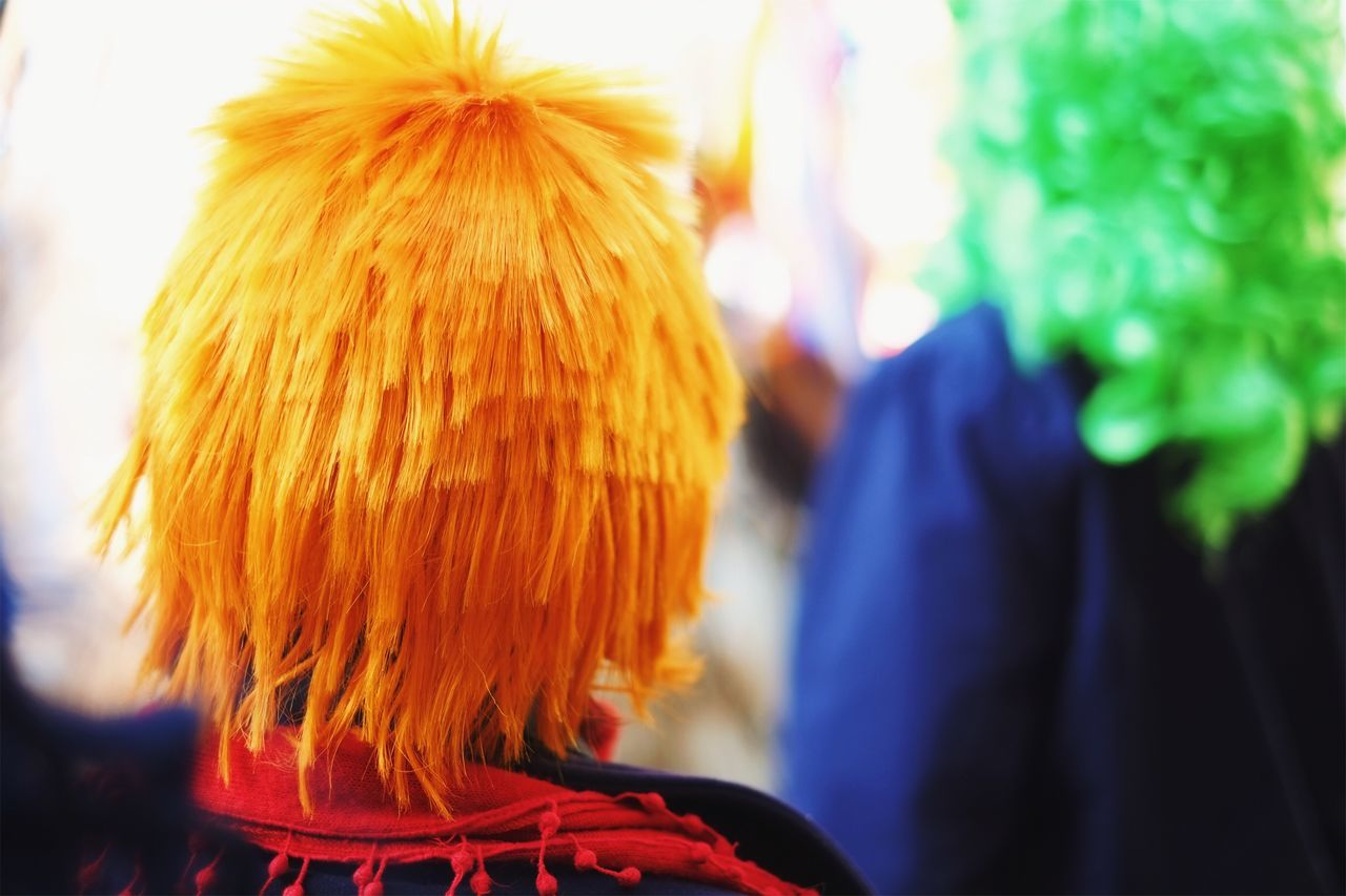 The spirit of Bowie is still among us. Real People Focus On Foreground Lifestyles Rear View Men One Person Outdoors Leisure Activity Women Day Close-up Carnival Orange Wig Colors Colorful Costume Party Streetphotography Authentic Moments Celebration Party Music