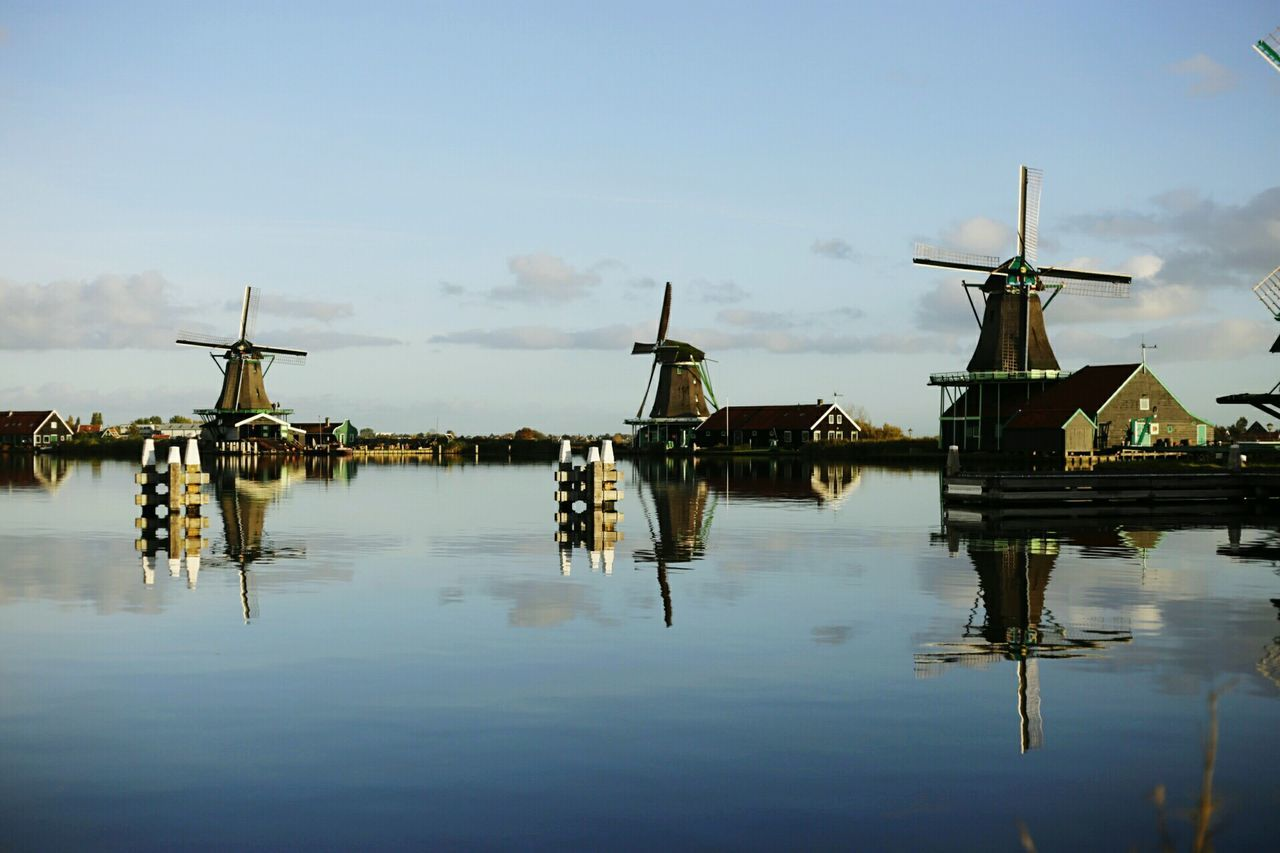EyeEm Selects Reflection Water Outdoors Wind Power Day Alternative Energy Wind Turbine Lake No People Nautical Vessel Sky Windmill Architecture Building Exterior Traditional Windmill Watermill Nature