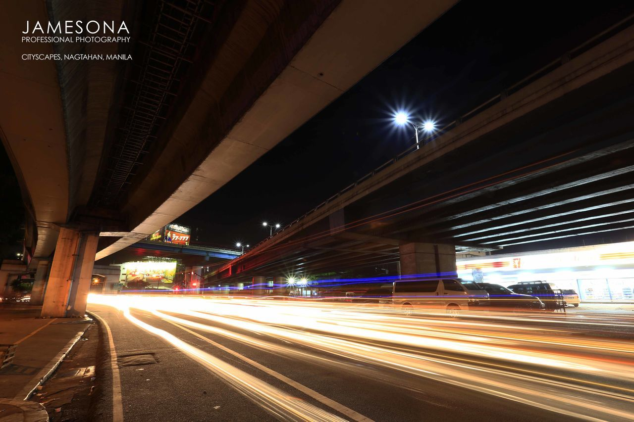 light trail, illuminated, speed, night, transportation, motion, long exposure, bridge - man made structure, blurred motion, traffic, architecture, road, connection, high street, street light, built structure, outdoors, city, no people