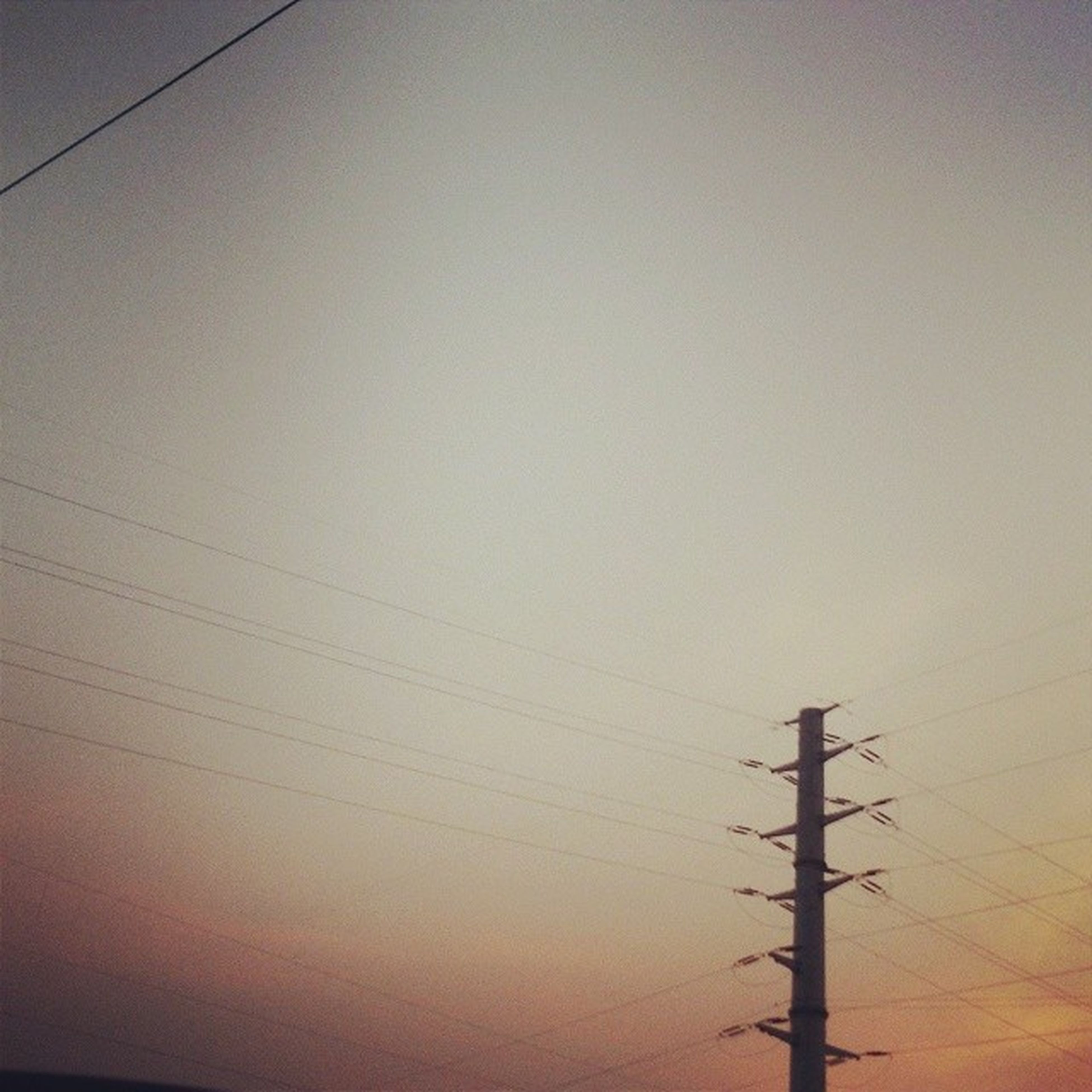 power line, power supply, electricity, electricity pylon, connection, cable, fuel and power generation, technology, low angle view, clear sky, power cable, silhouette, sunset, tranquility, sky, copy space, outdoors, no people, nature, tranquil scene