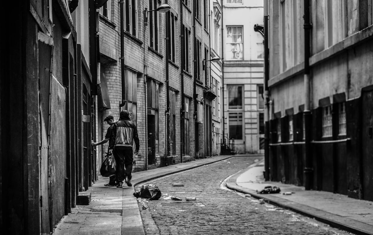 architecture, building exterior, real people, built structure, one person, transportation, day, men, outdoors, city, full length, lifestyles, one man only, people