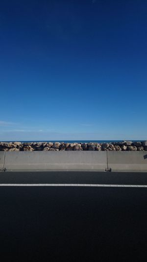 Highway EyeEmNewHere Sea Water Road Rock - Object Sky Blue Black Beach SPAIN Blue Sand Beach Sea Desert Nature Animals In The Wild Day No People Beauty In Nature EyeEmNewHere Copy Space Scenics Arid Climate Clear Sky Landscape Tranquility Transportation Outdoors Tranquil Scene