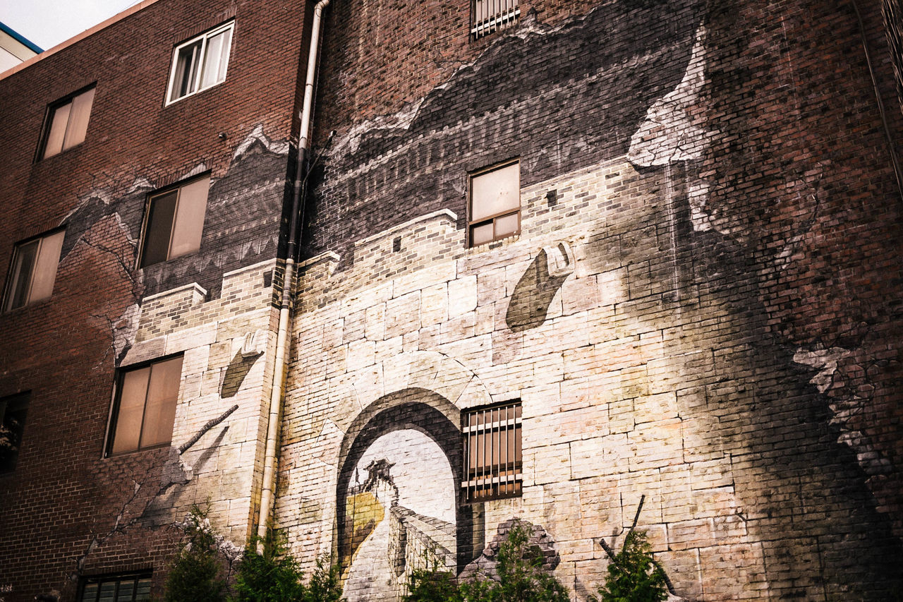 architecture, building exterior, brick wall, window, built structure, outdoors, day, no people, city