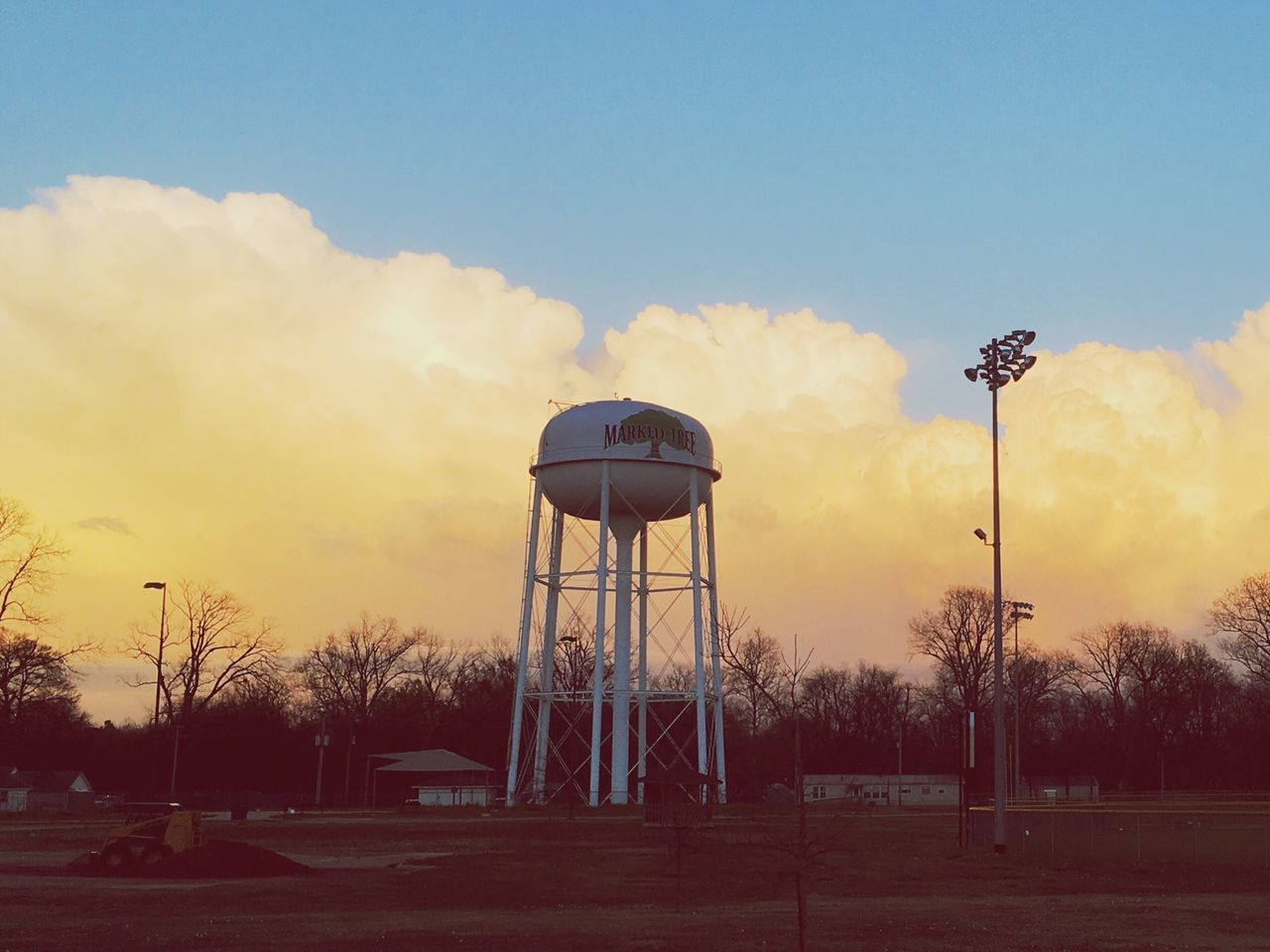 sky, storage tank, water tower - storage tank, cloud - sky, water tank, water conservation, built structure, tree, outdoors, no people, architecture, nature, sunset, bare tree, day