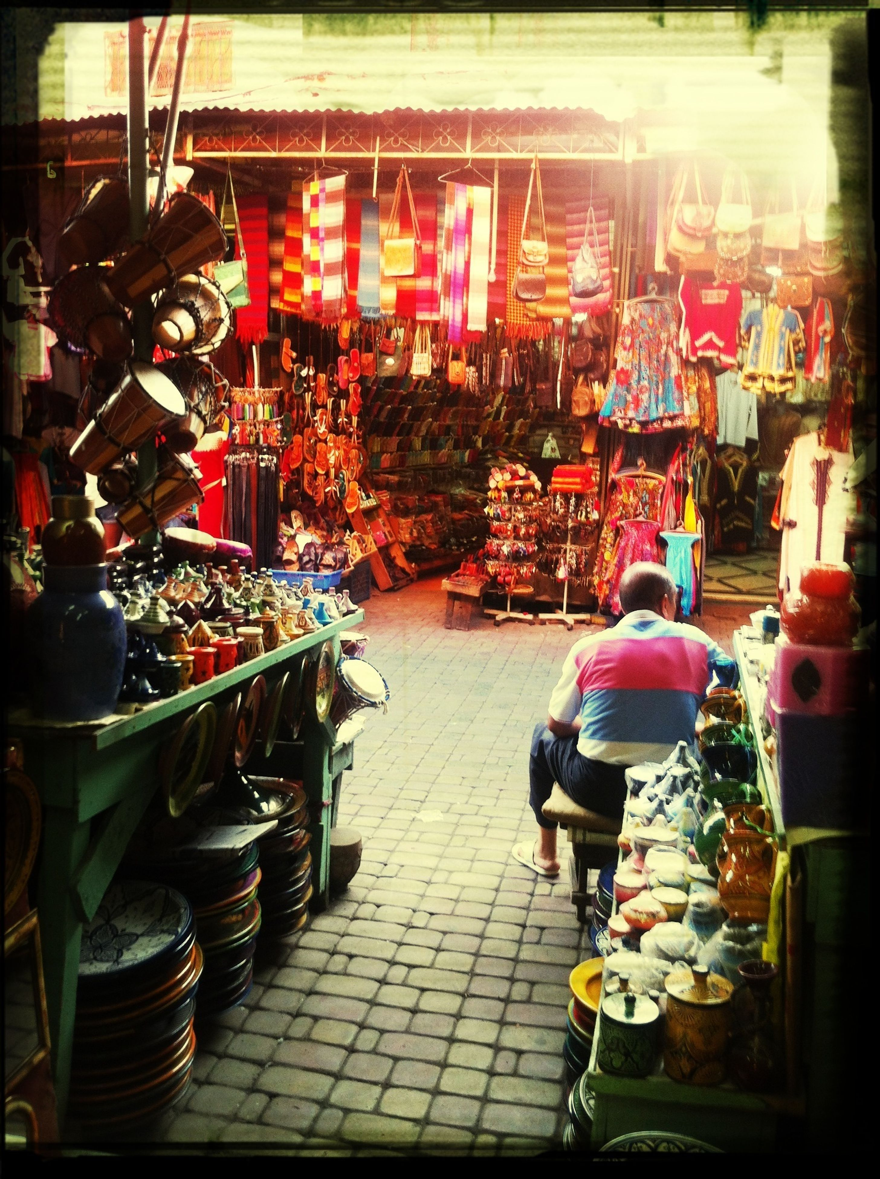 retail, market, men, market stall, for sale, large group of objects, store, street, person, transfer print, small business, lifestyles, abundance, shopping, choice, selling, auto post production filter, walking, variation