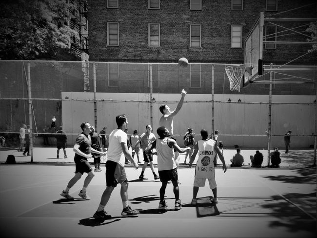 Basketball Blackandwhite Cage Casual Clothing City City Life City Life Courtyard  Day Full Length Leisure Activity Lifestyles Mixed Age Range NYC NYC Street Nyc Street Life NYC Street Photography Outdoors Playing Sport Up Close Street Photography