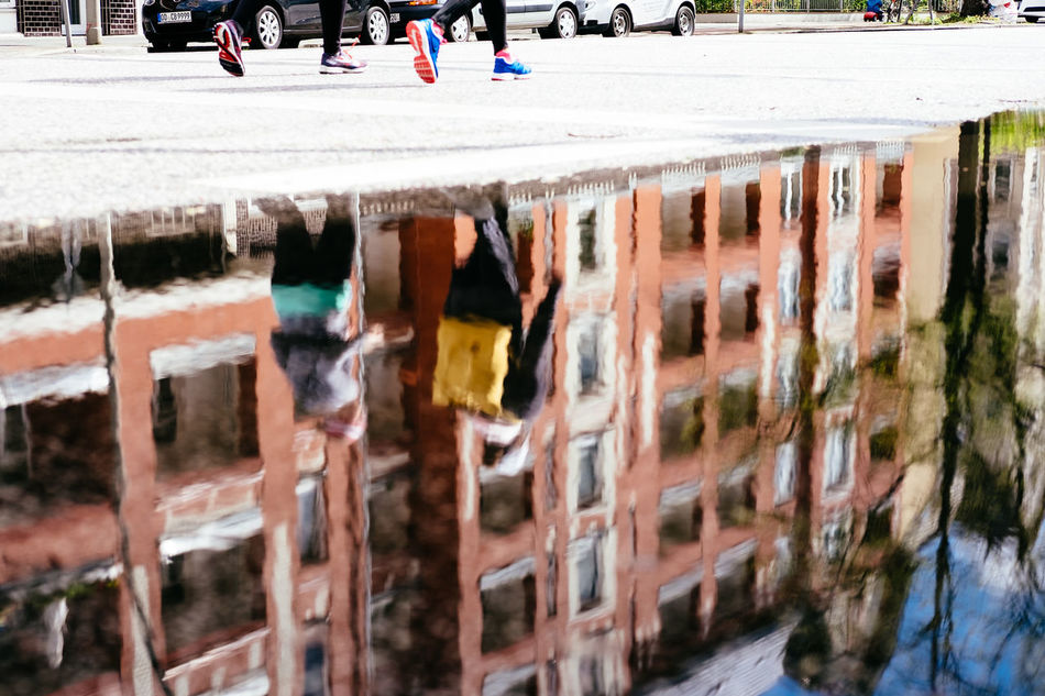 Architecture Day Outdoors Puddle Real People Reflection Run Running Sport Water