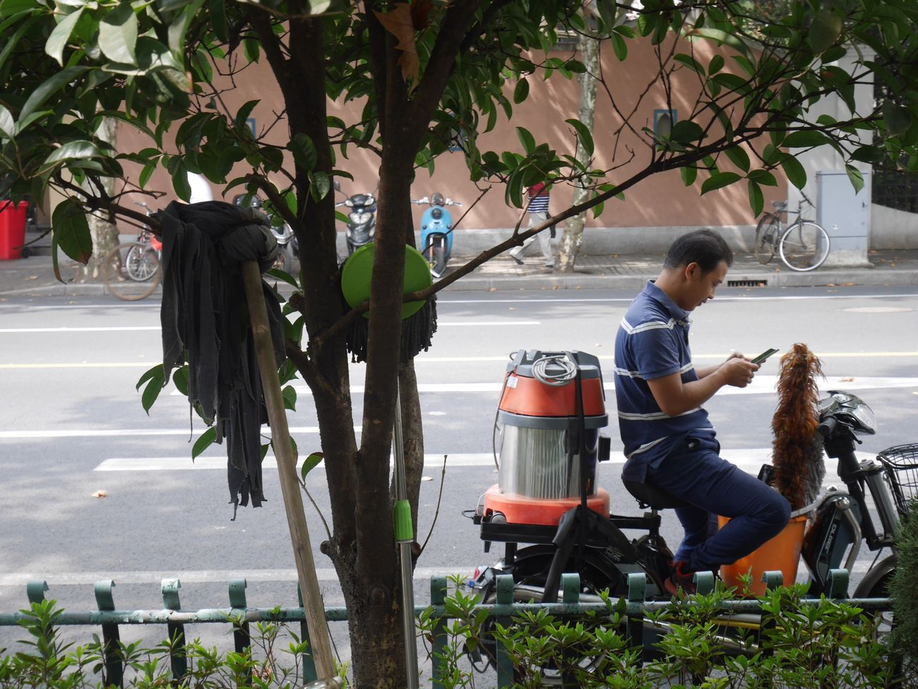 Shanghai . Full Length Tree Casual Clothing Sitting Outdoors Leisure Activity One Person Growth Day Nature Adult Mobile Conversations Shanghai Shanghai Streets Technology Streetphotography Street Photography Conversation Communication Street