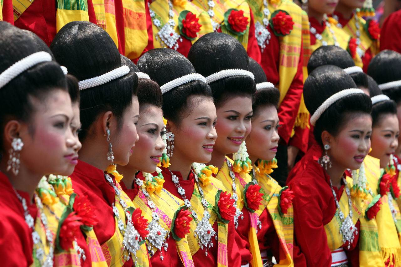 traditional clothing, in a row, cultures, large group of people, real people, tradition, celebration, togetherness, men, outdoors, boys, day, traditional dancing, chinese new year, standing, traditional festival, women, young adult, people