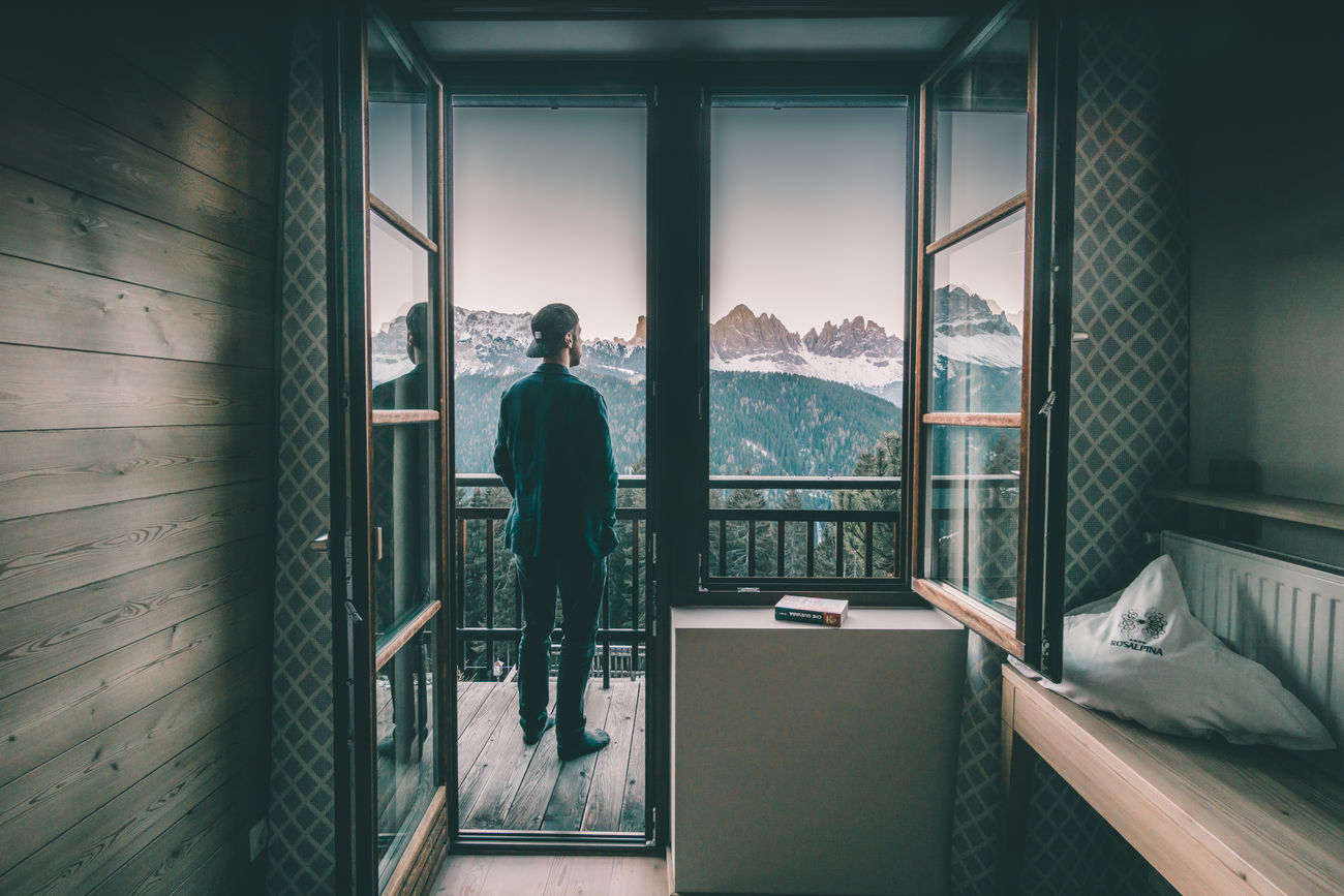 Man watching sunrise in the Dolomites from the hotel room balcony Alps Beautiful Nature Bressanone Dolomites Geisler Hotel Hotel Room Italia Italy Landscape Live Live Music Mountain Mountains Palmschoss Plant Road Rosalpina Do Rosalpina Dolomites South Tyrol Sud Sudtirolo Sunisshining Südtirol Brixen