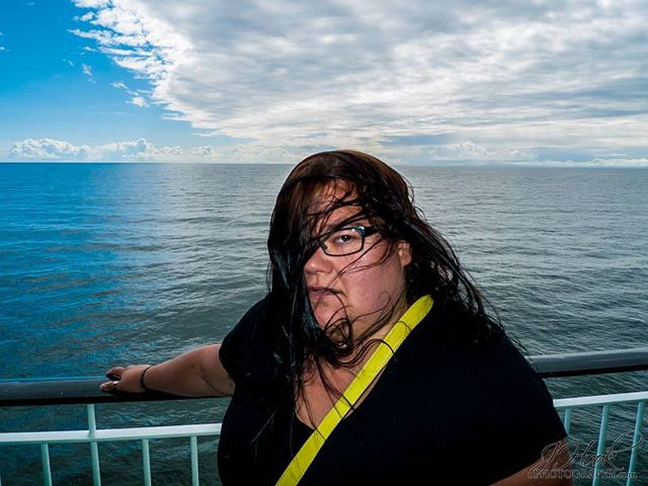 A Somewhat Pissed off Model on a Cruise Boat a couple months ago. Pissed off at the Wind not me.. A Realistic Capture of a completely Normal situation. The model in this photo is my better half for 10 years. Malli Laivalla Vituttaa Tuulee