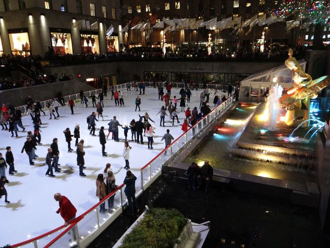 The Culture Of The Holidays New York New York City ice skating Christmas Lights City Life Tourism Night Rockefeller Center Large Group Of People Rockefeller Ice Rink Wintertime Winter Wonderland Winterscene